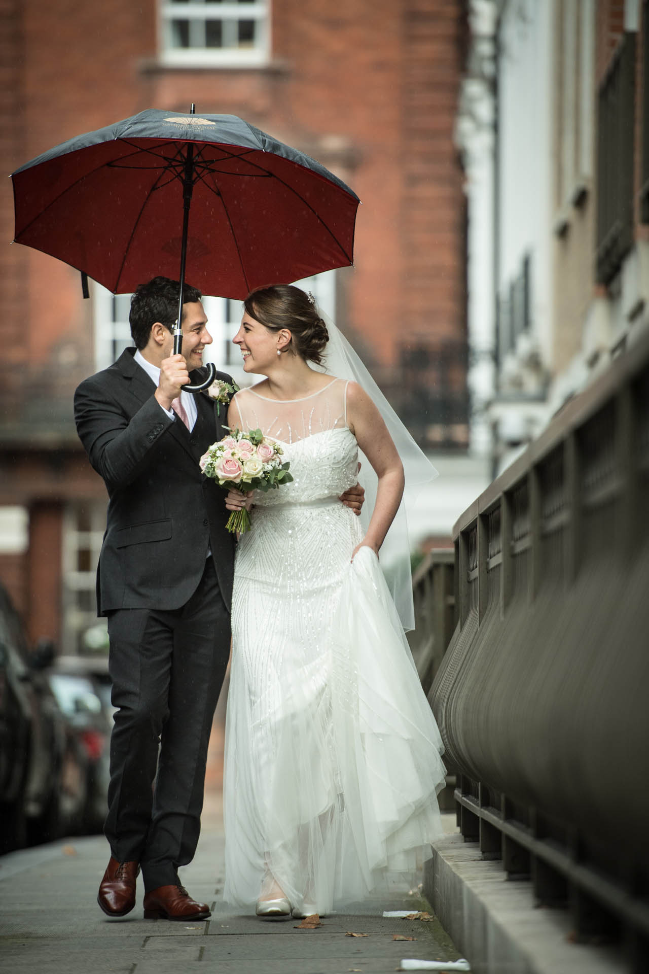 The Dorchester Hotel, London UK Elopement Couple Image | This couple doesn't mind getting caught in the rain