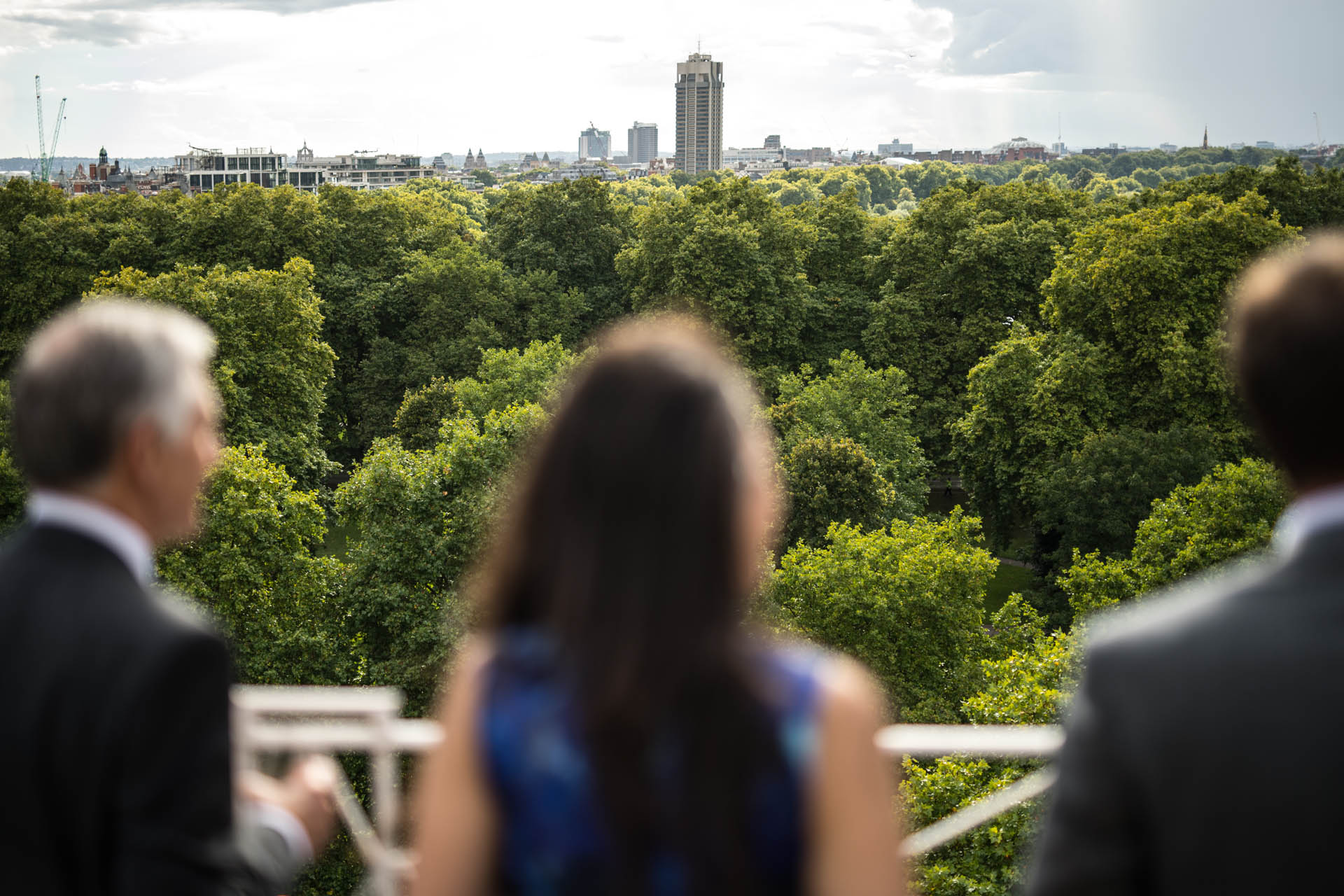 The Dorchester Hotel, London Elopement Venue Picture | A few of the guests take in the view from the Harlequin Suite