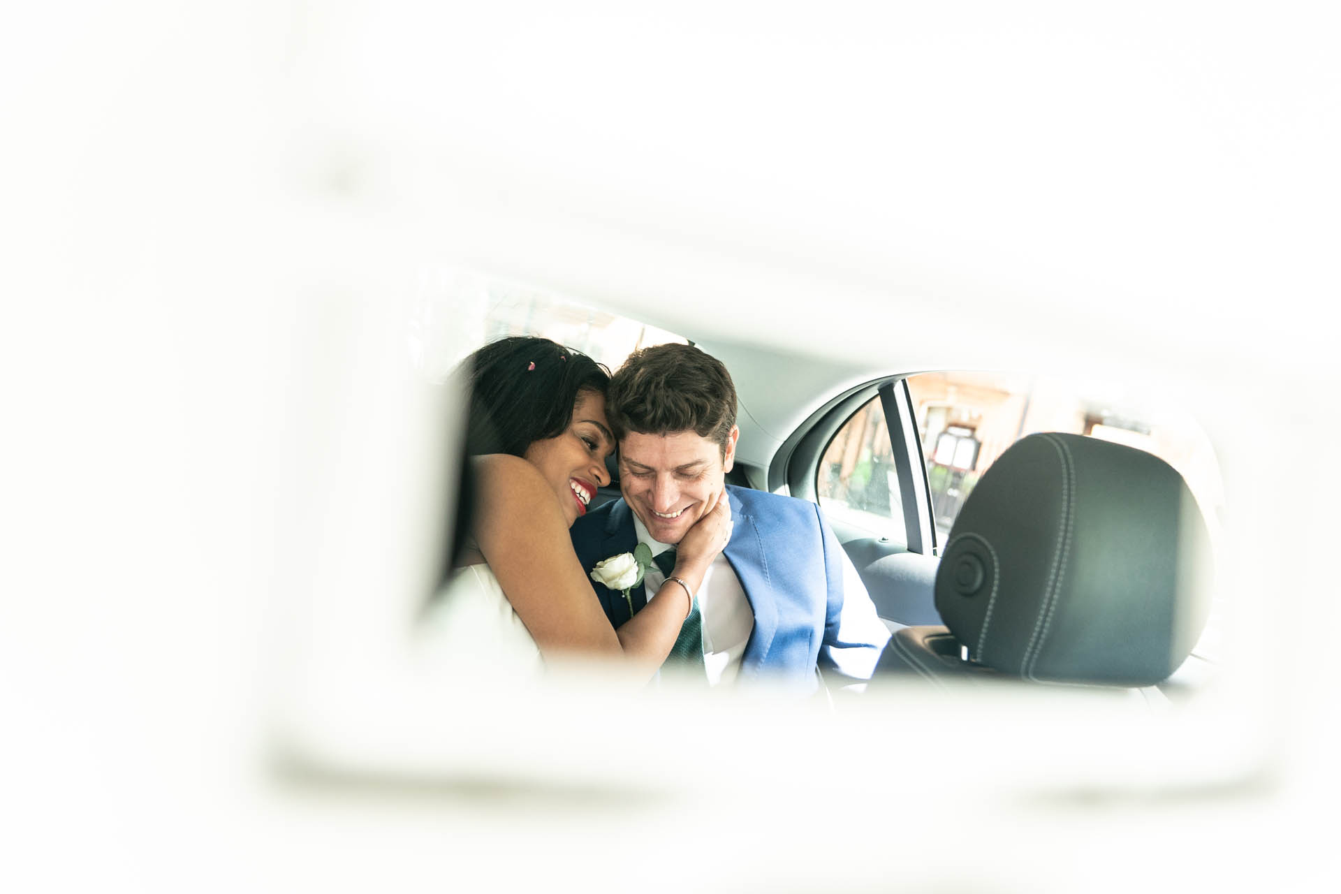 London Elopement Couple Photo | The bride and groom share a beautiful minute together in the cab