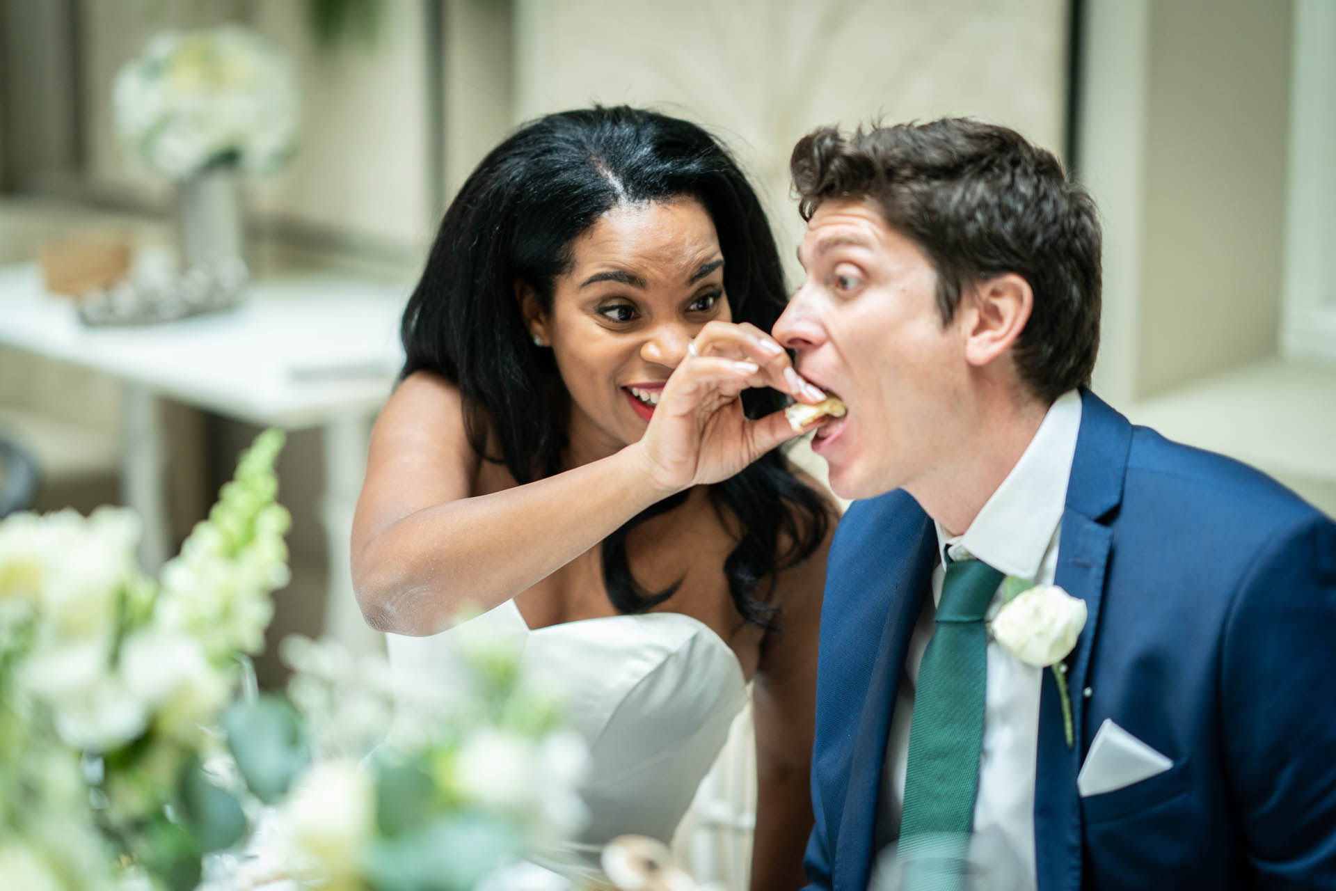 Somerset House of London - Elopement Reception Venue Image | The bride feeds the groom during the wedding meal
