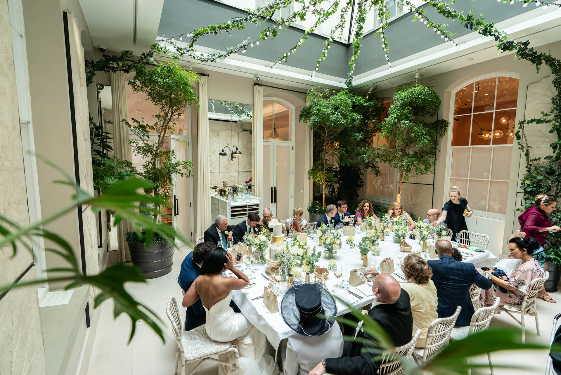 London's Somerset House Elopement Reception - Venue Event Photography | The guests enjoying a wedding feast