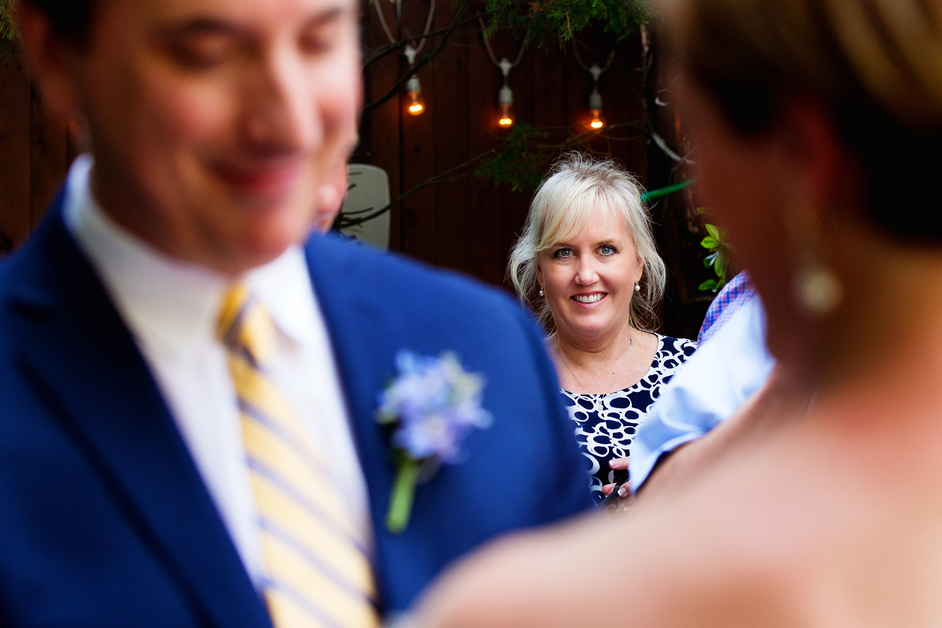 New Jersey Outdoor Elopement Ceremony Picture | A guest looks on the intimate wedding ceremony