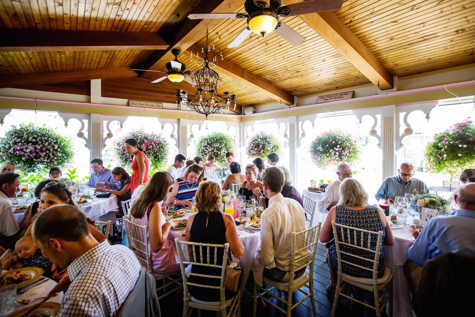LBI Elopement Reception Reception Venue Images | Guests enjoy al fresco dining on the beautiful porch