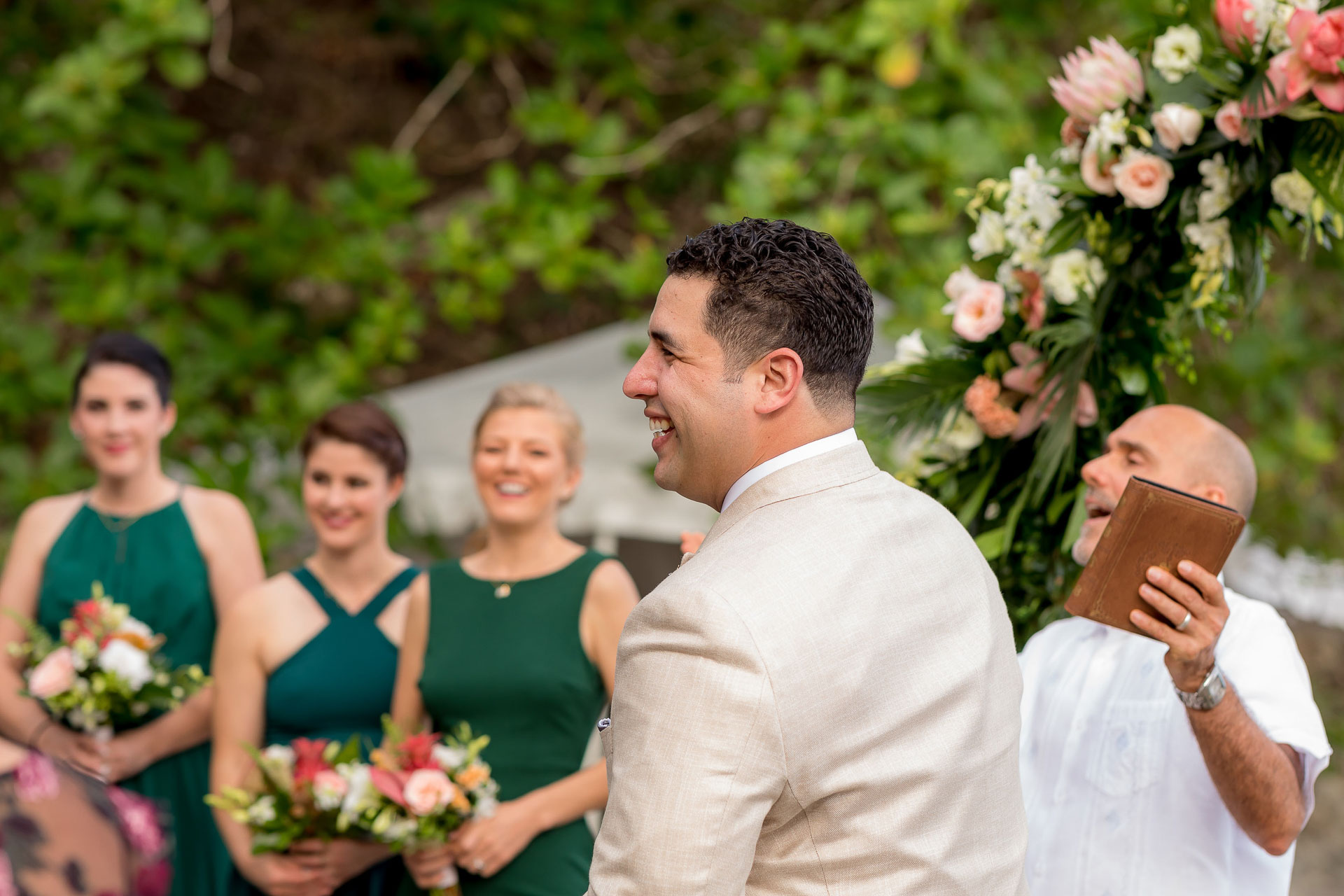Beach front and Rainforest Resort outdoor elopement photos, Costa Rica | The ceremony is held outside beneath a beautiful, floral arch