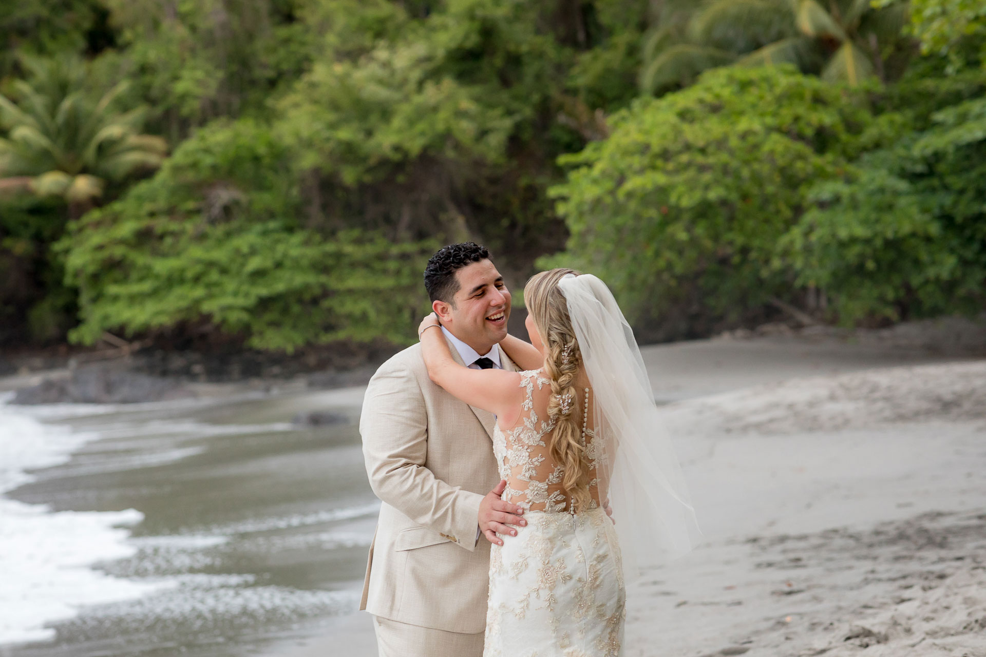 Beach couple elopement portrait from Costa Rica | The newlyweds make the most of their beach wedding surroundings