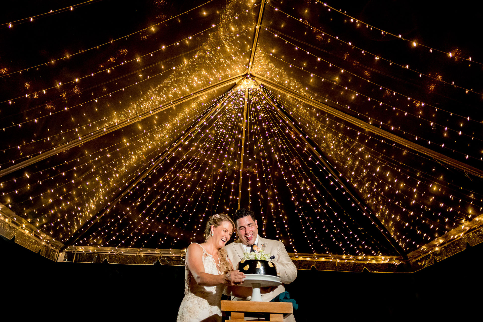 Arenas del Mar Costa Rica elopement reception venue photos | The newlyweds stand together beneath a tent of sparkling lights