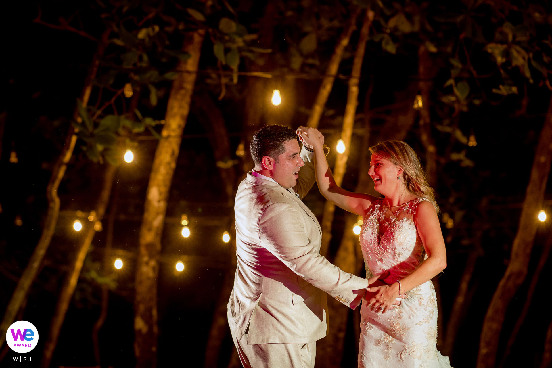 Arenas del Mar Beachfront and Rainforest Resort, Costa Rica Elopement Photos | The couple dance the night away surrounded by trees and twinkling lights