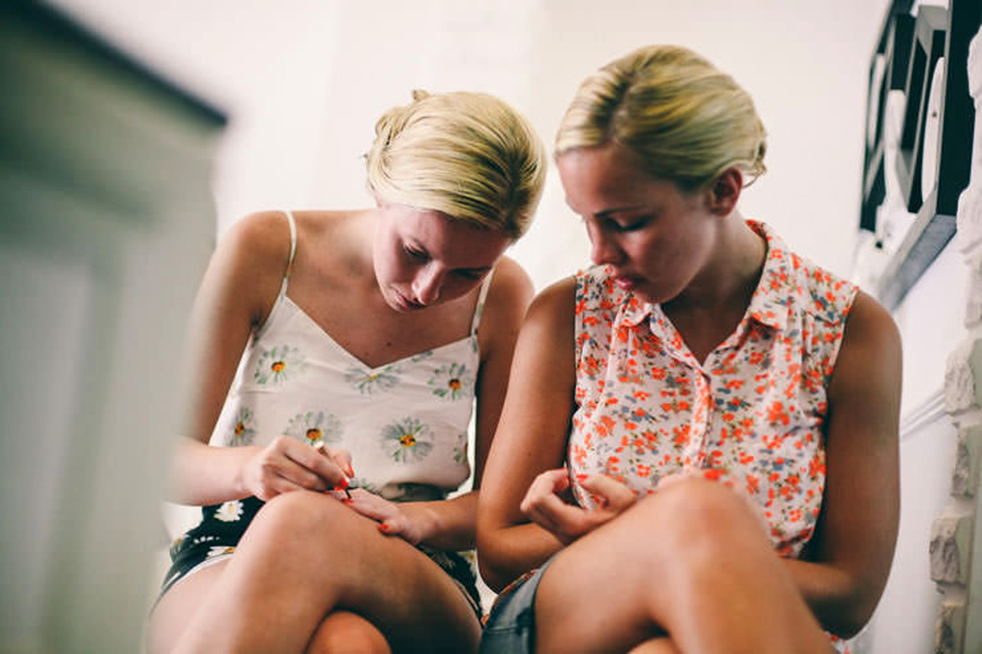 Oludeniz, Fethiye, Turkey Destination Elopement Photography | The bride's sisters work on applying their own nail polish