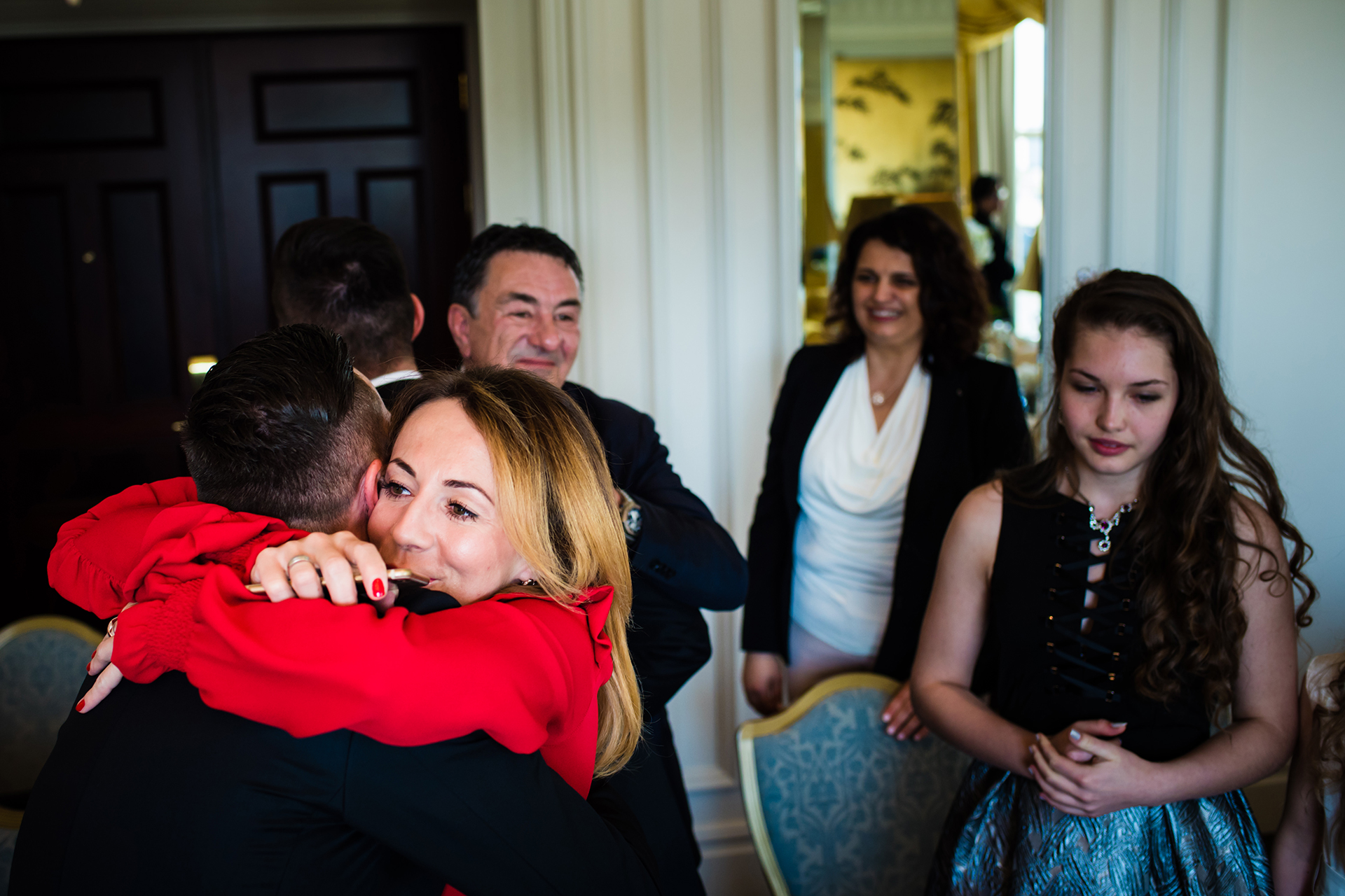 The Savoy Hotel Elopement Photography | A hug of congratulations is given after the marriage ceremony