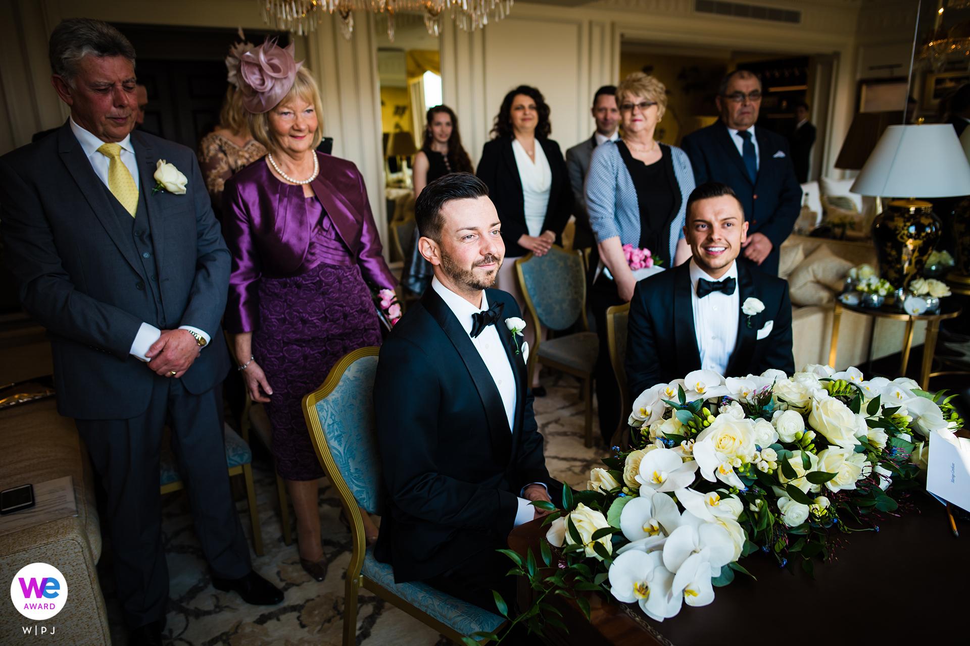 The Savoy Hotel London Elopement Photographer | Close family enjoy the wedding ceremony