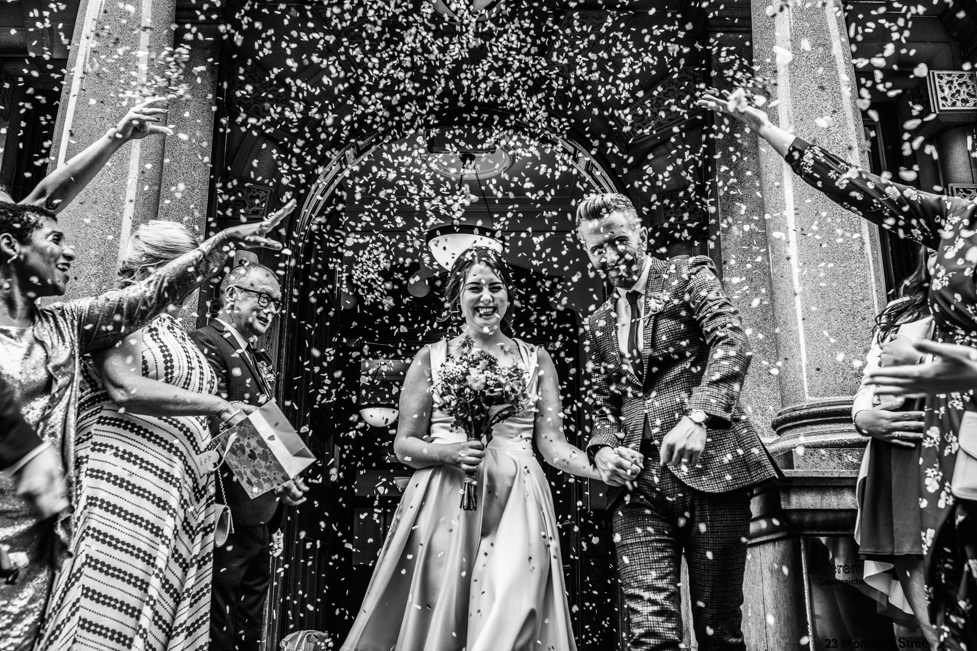 Glasgow, Scotland - City Chambers Elopement Ceremony Photo | Even with less than 30 guests, you can still get a great confetti shot