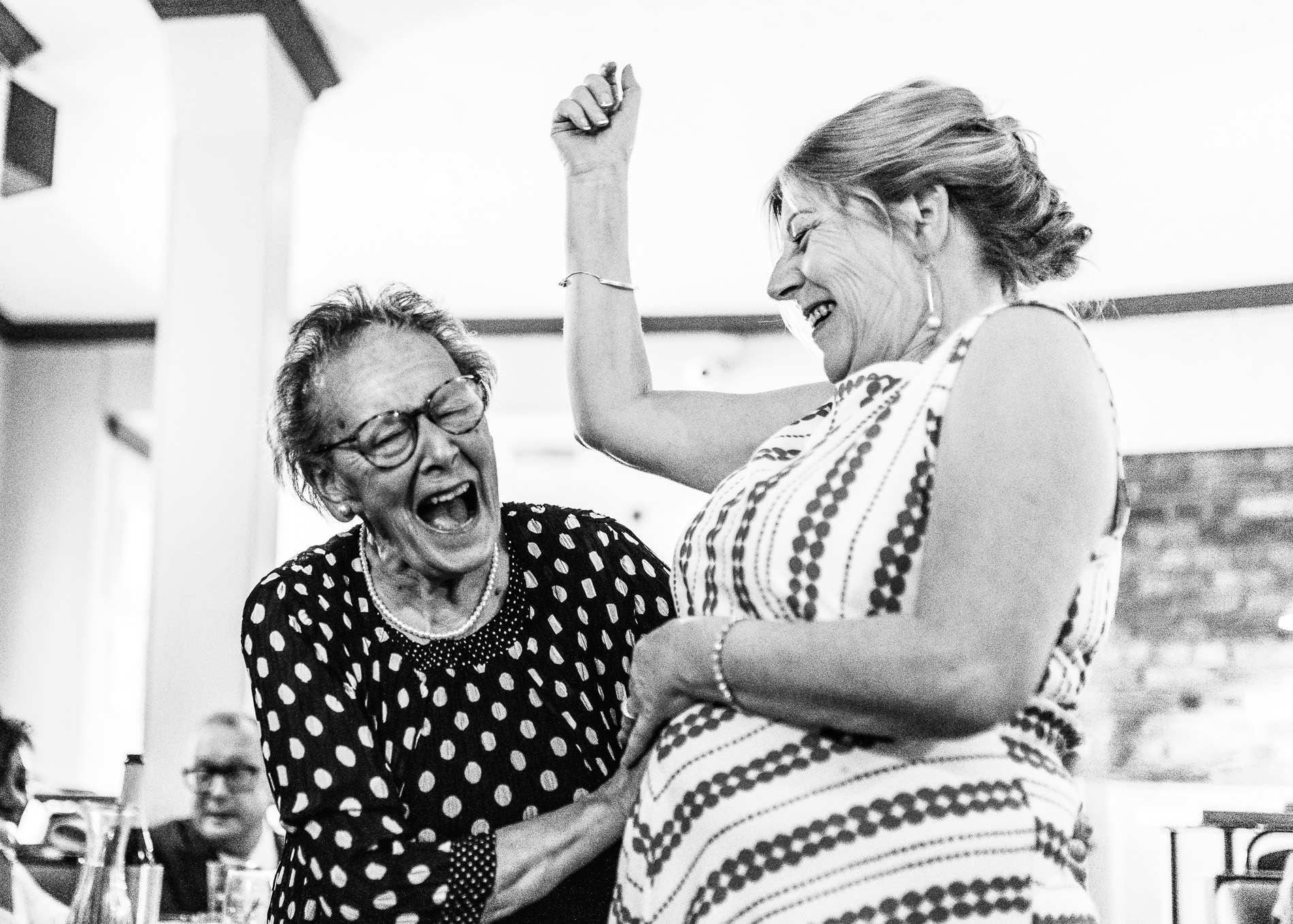 Scotland UK Elopement Photo | Bride's mum and her nan have a giggle in the pub