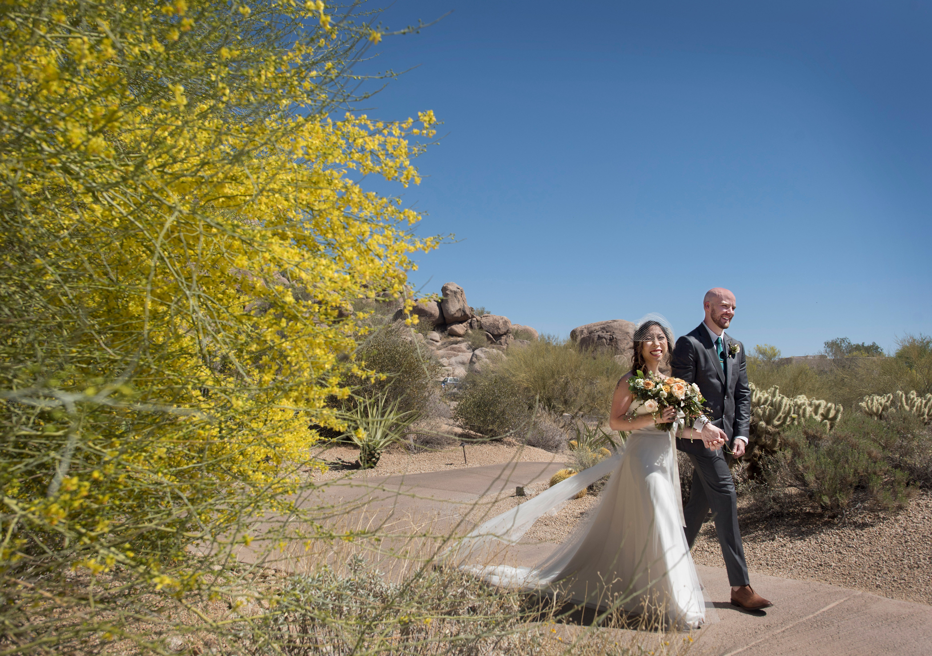 Arizona Outdoor Elopement Ceremony Picture | After the ceremony, the couple goes for a walk through the natural desert landscape