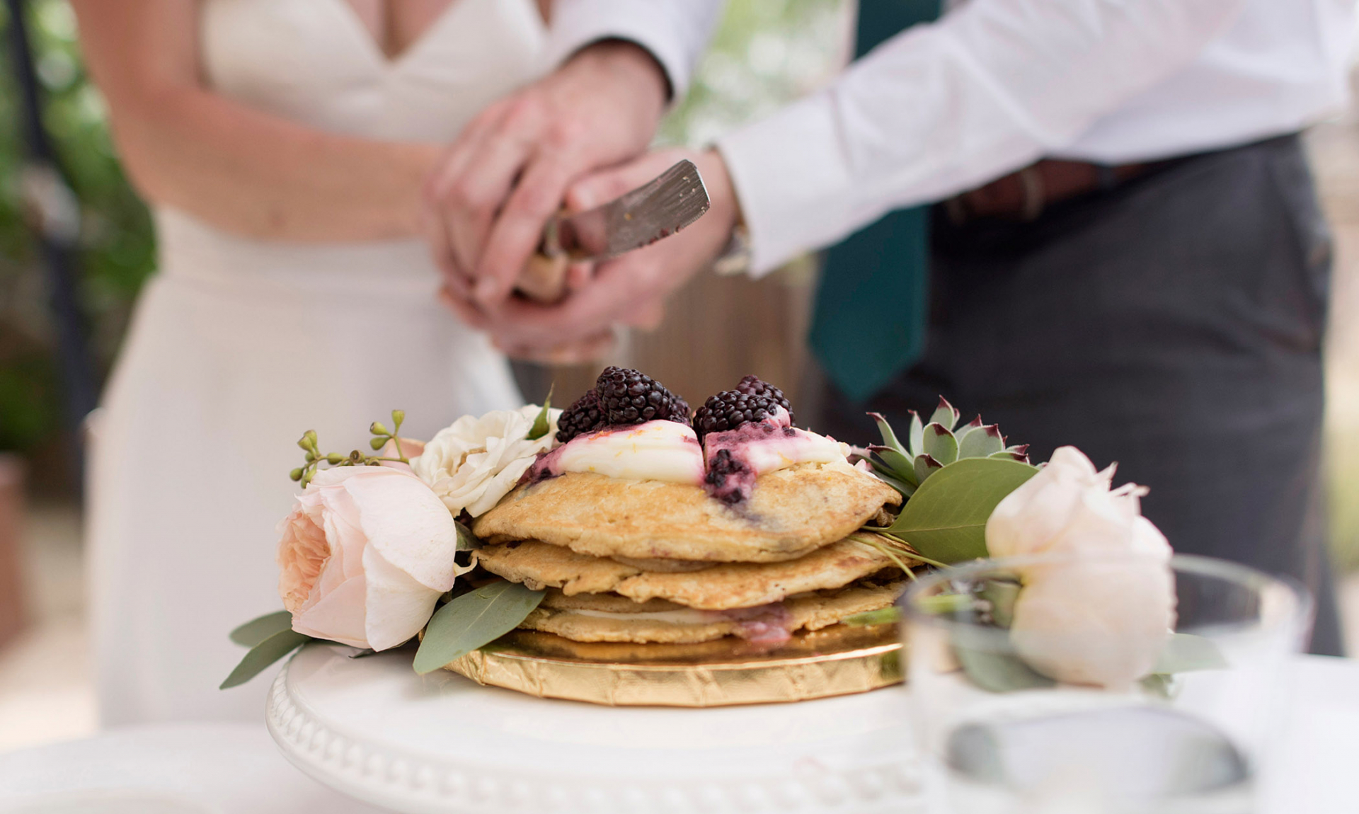 Scottsdale, AZ Elopement Cake Cutting Detail Image | This couple decided to take brunch seriously and cut into their pancake wedding cake