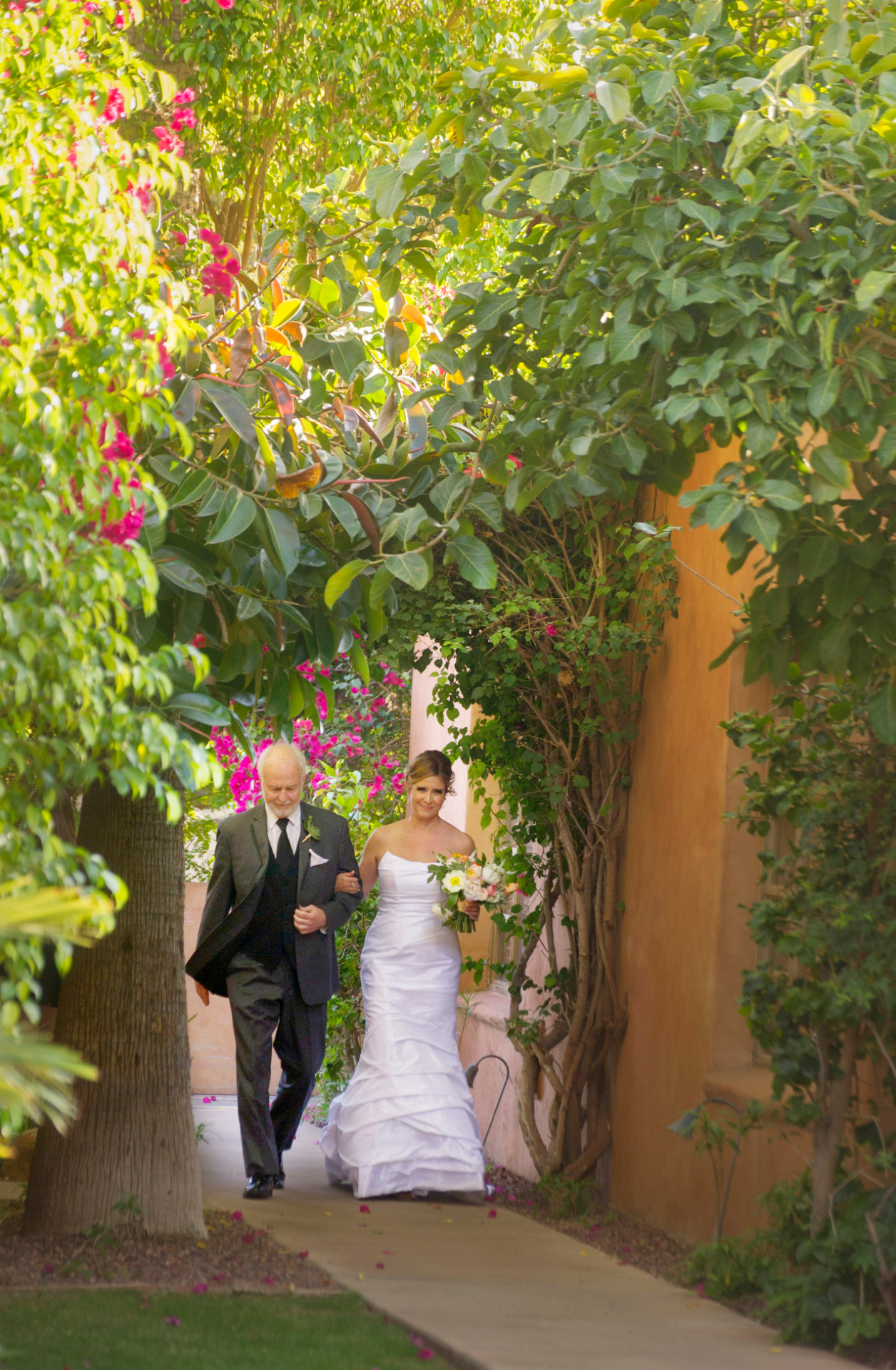 Royal Palms, Phoenix Elopement Image | The bride and her father walk together to the outdoor wedding ceremony