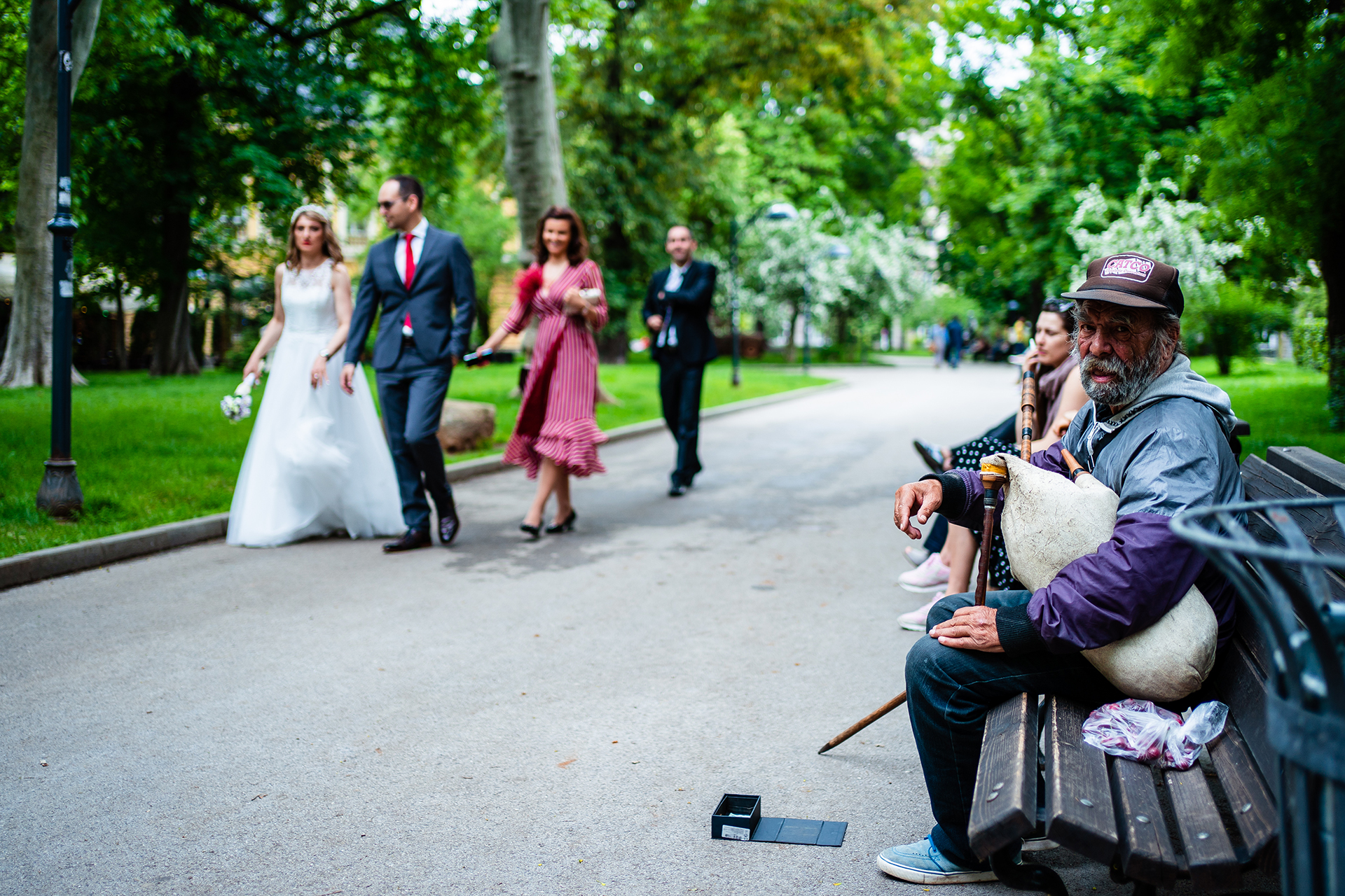 Sofia, BG Elopement Couple Walking Portraits | A street musician played the typical folklore bagpipe music