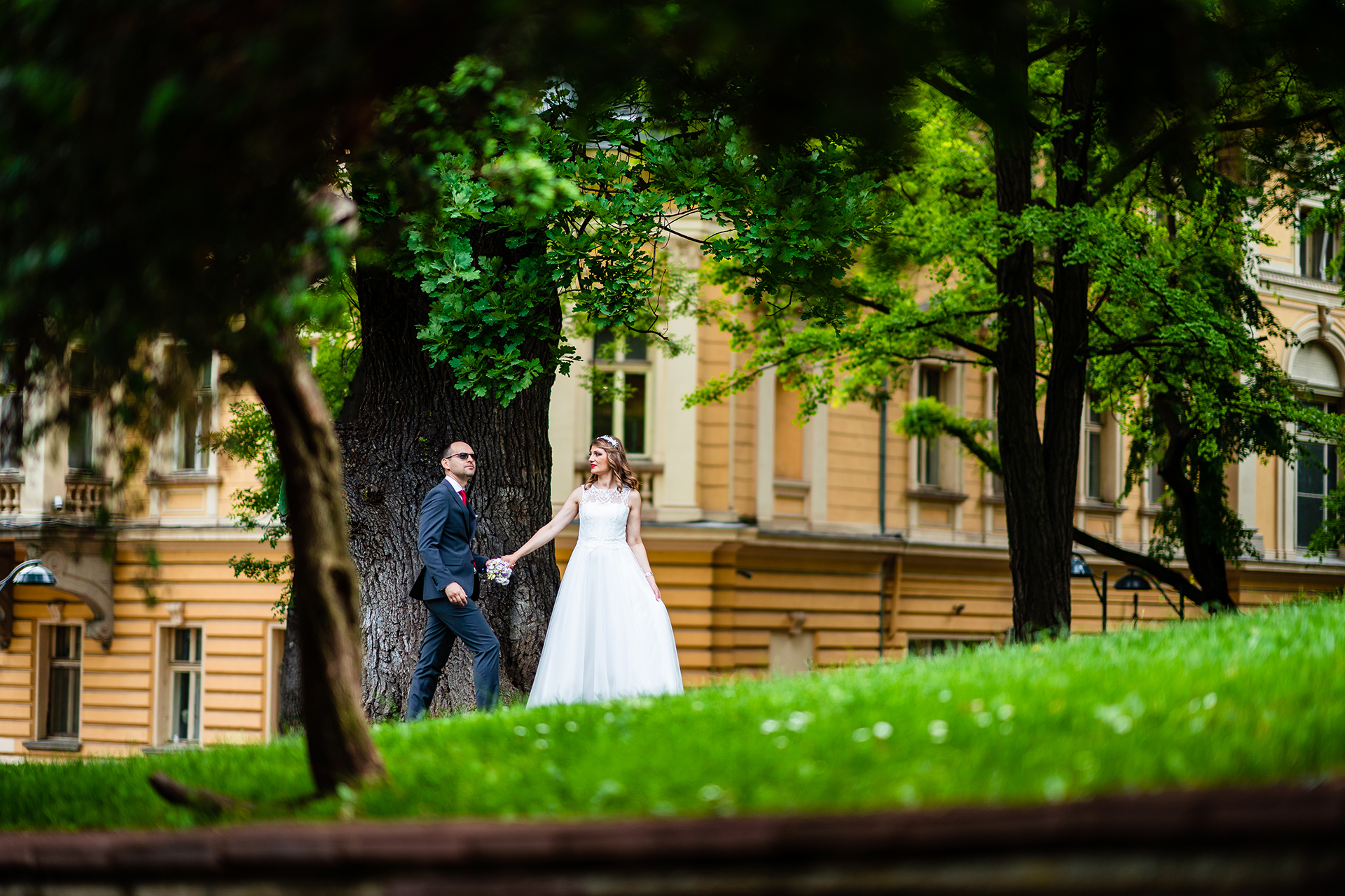 Sofia Elopement Couple Portrait Photography | The bride is holding the hand of her husband while having a relaxing walk