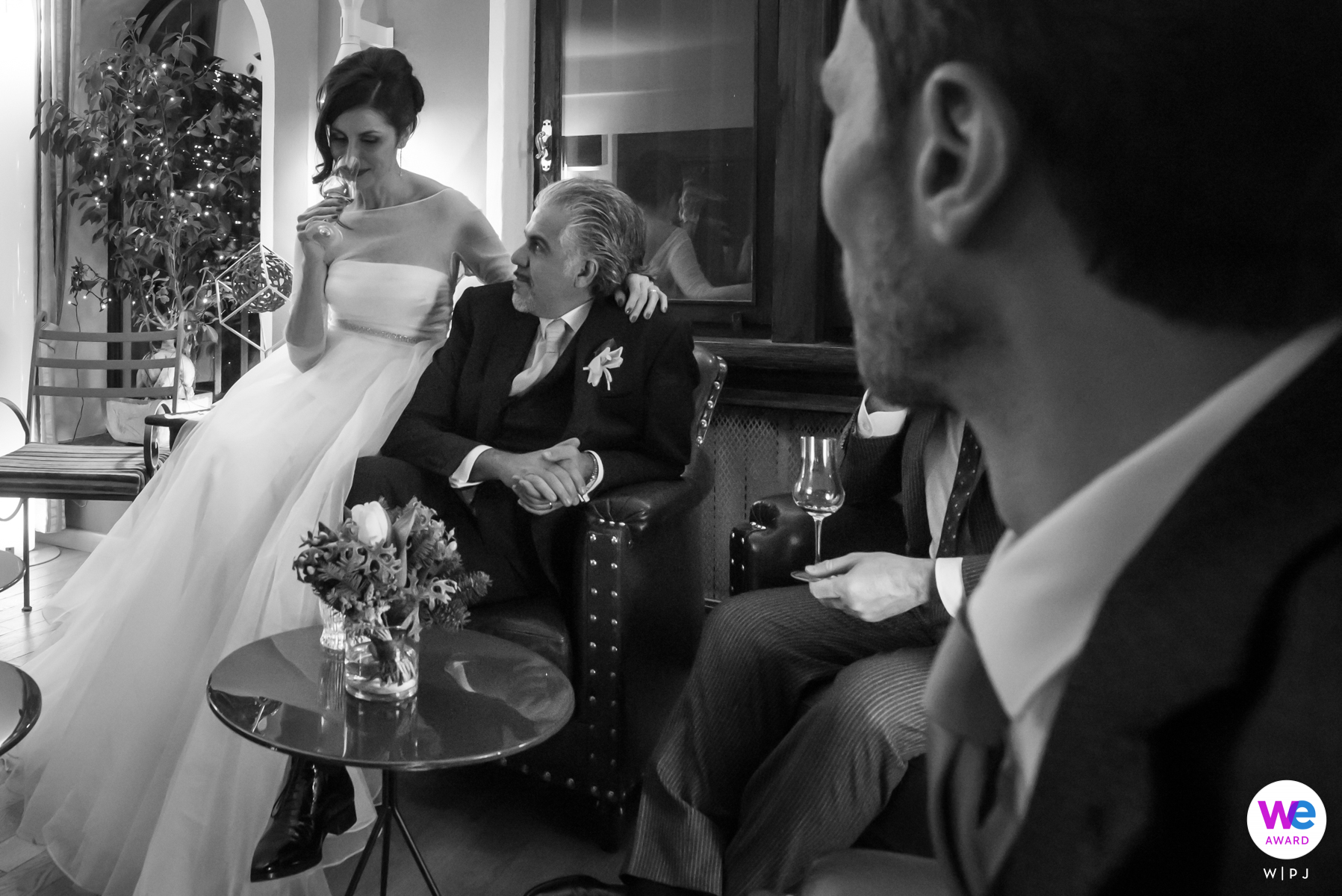 Restaurant Dal Pescatore - Mantua, Italy Elopement Photography | The spouses and friends reach a sitting area in the room