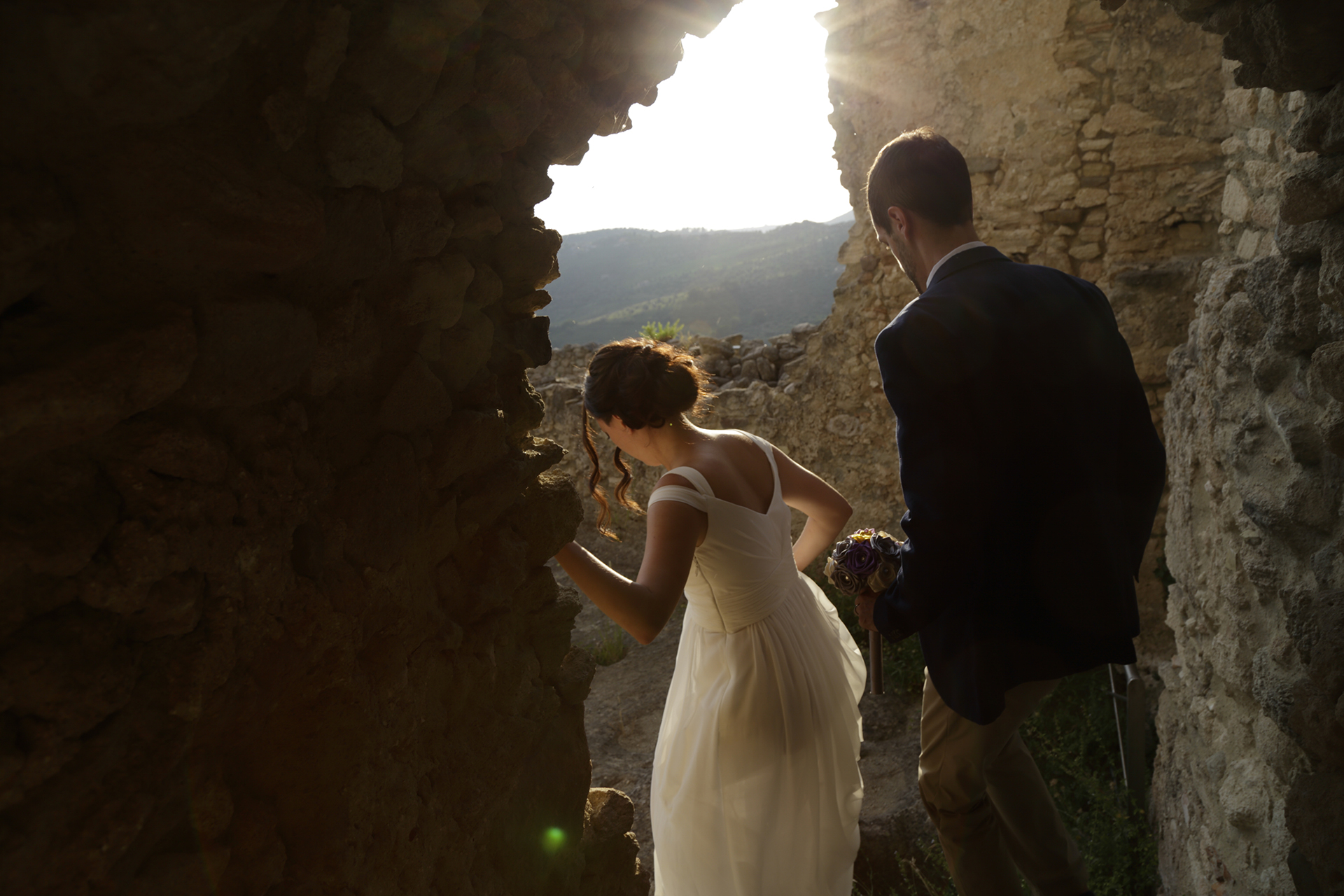 Calabria, Italy Outdoor Elopement Photographer | After the ceremony, the bride and groom descend from the castle