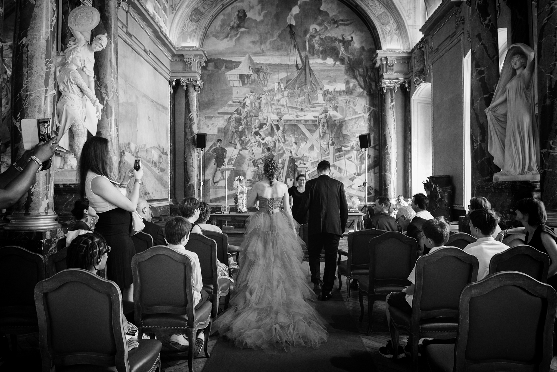 Toulouse City Hall, France Elopement Photo | The bride and groom walk down the aisle together
