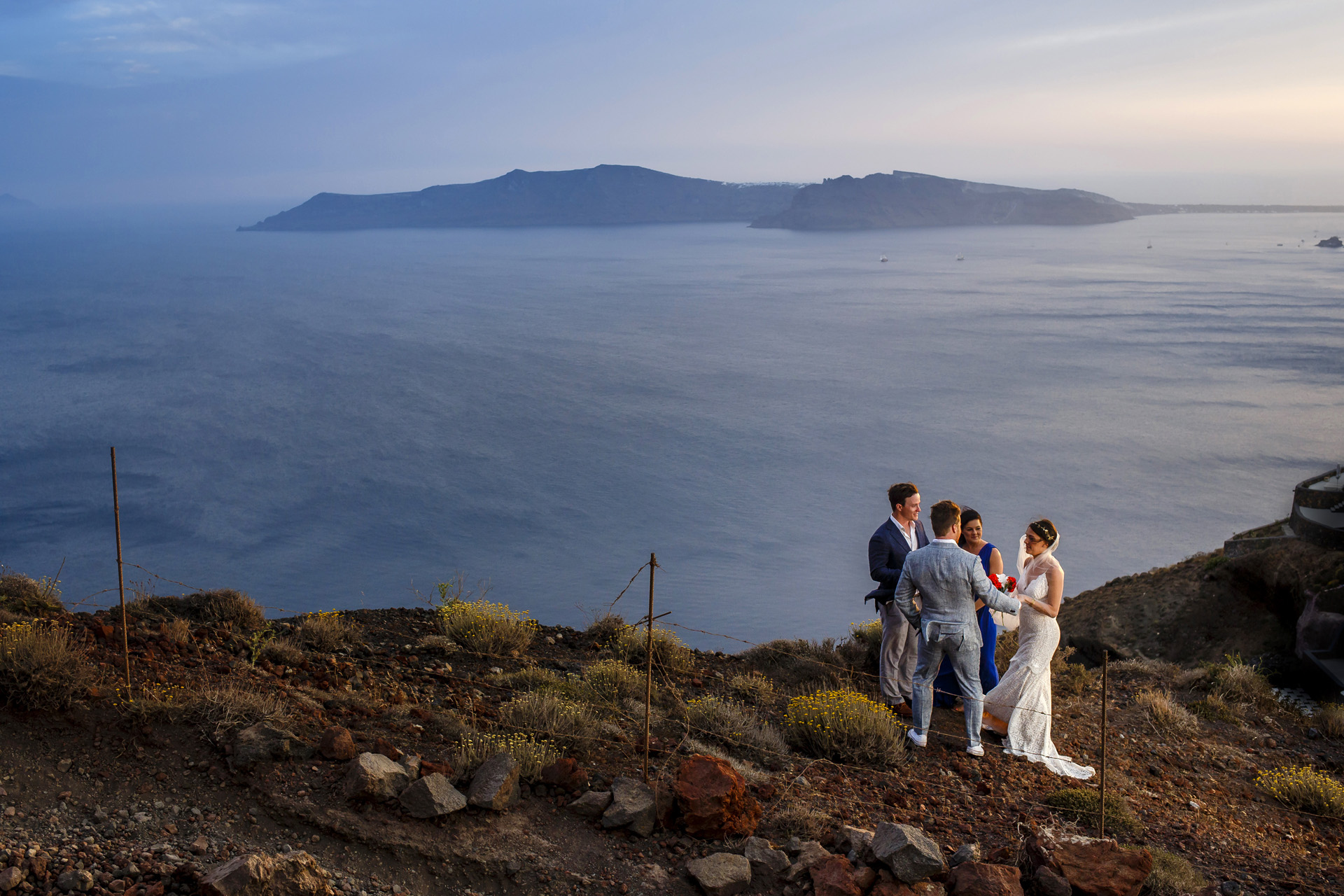 Fira, Santorini, Greece Elopement Ceremony Photography | after climbing the rocks, We came together at sunset