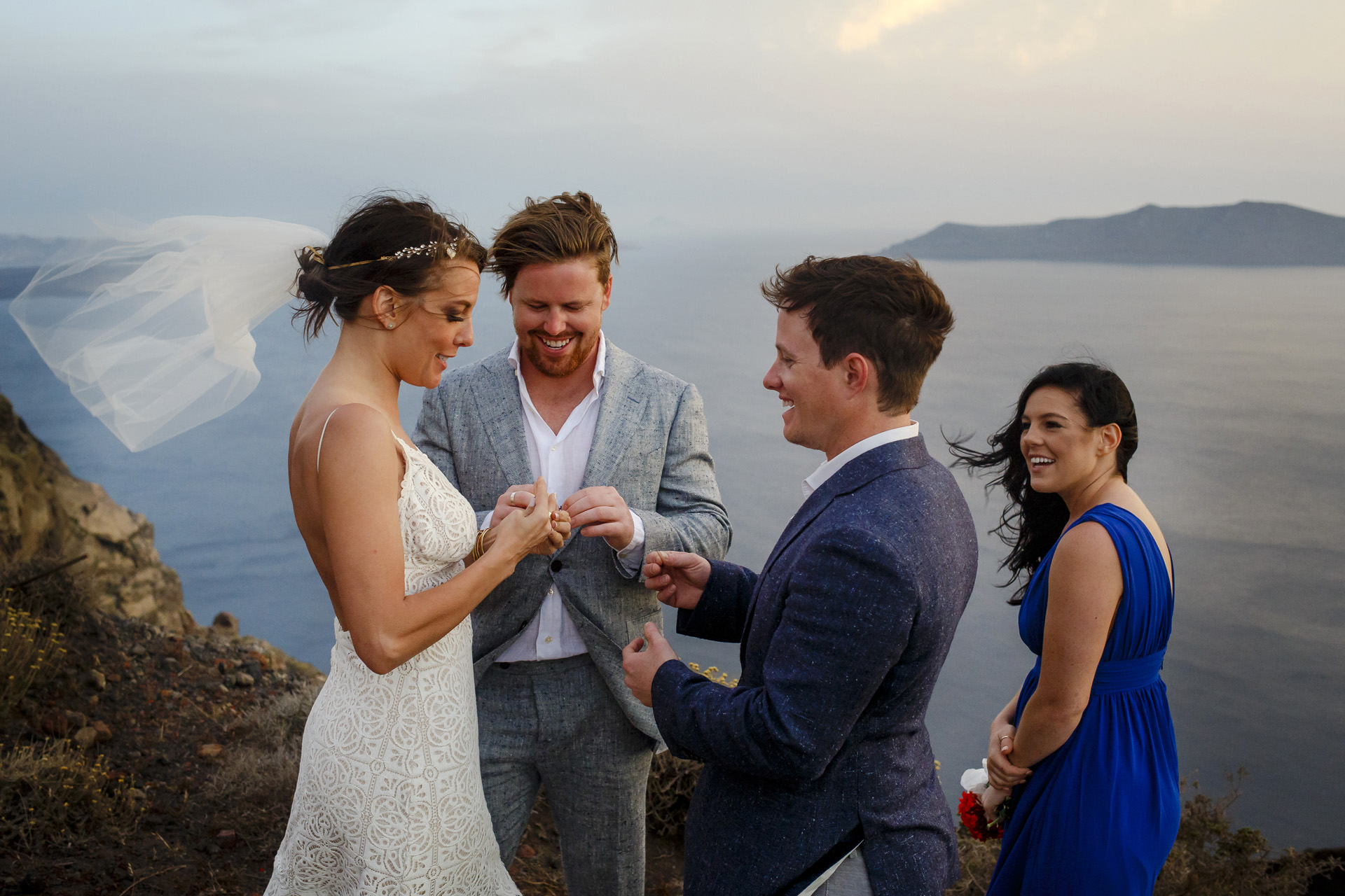 Fira, Santorini, Greece Beach Elopement Ceremony Photographer | the marriage ceremony with a wonderful speech