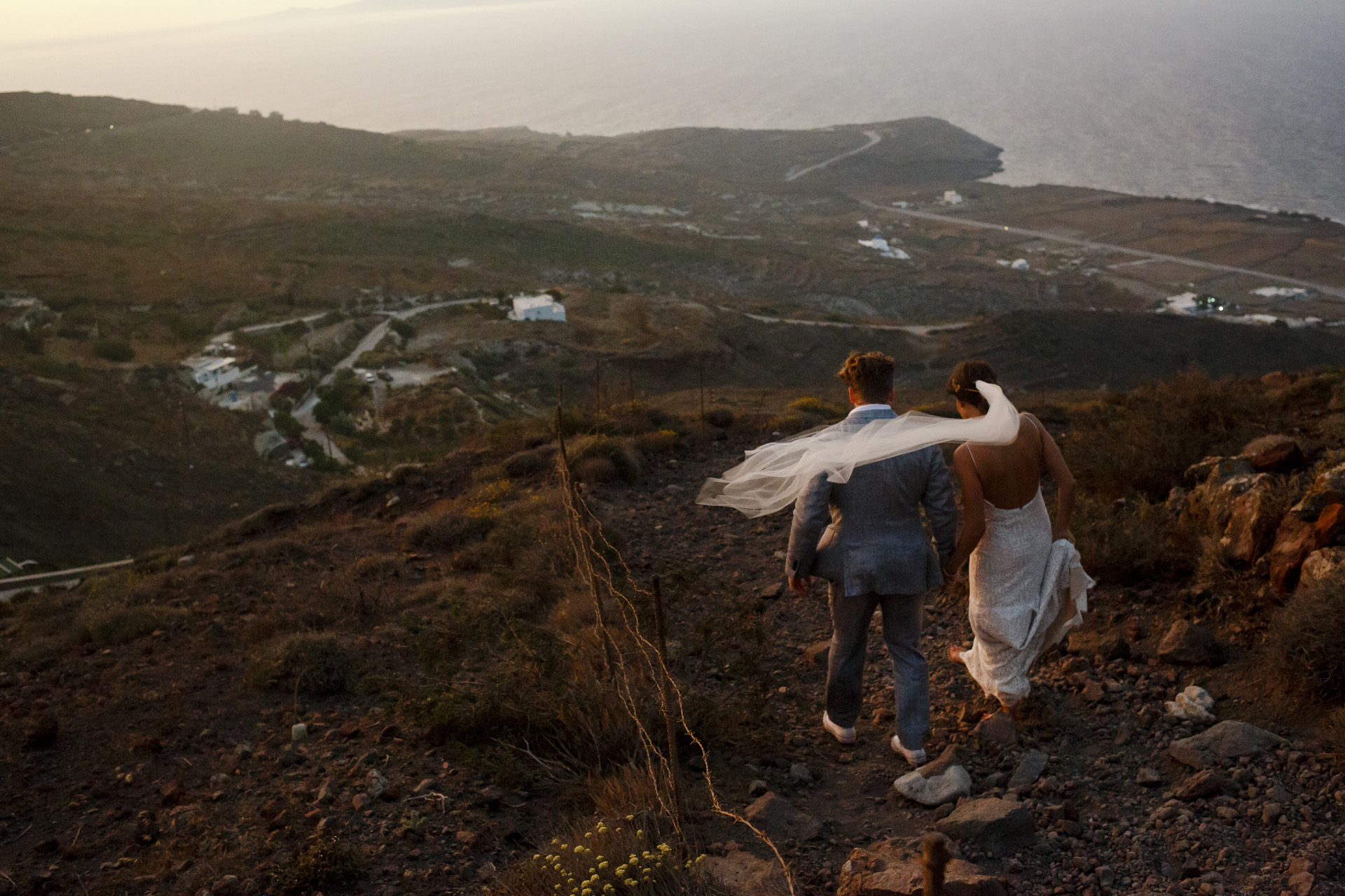 Fira, Santorini, Greece Beach Elopement Image | At the end of the ceremony, we went down from the cliff for the dinner