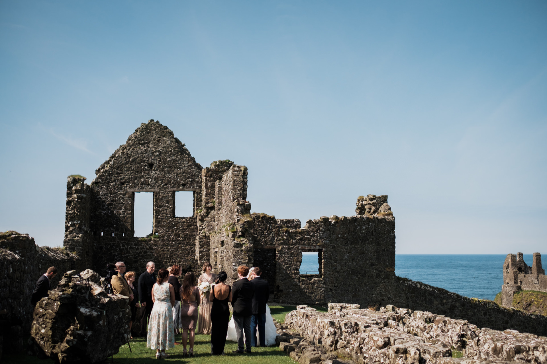 Dunluce Castle weddings in Northern Ireland - Elopement Photography | Wide shot of part of the ruins of Dunluce Castle