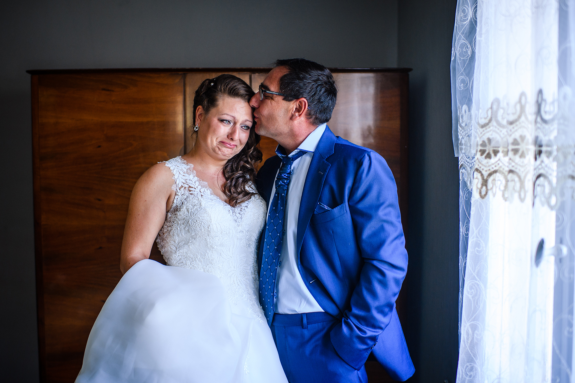Image created at a Ribaritsa, Bulgaria Elopement | the bride's father gives her a loving kiss on the forehead