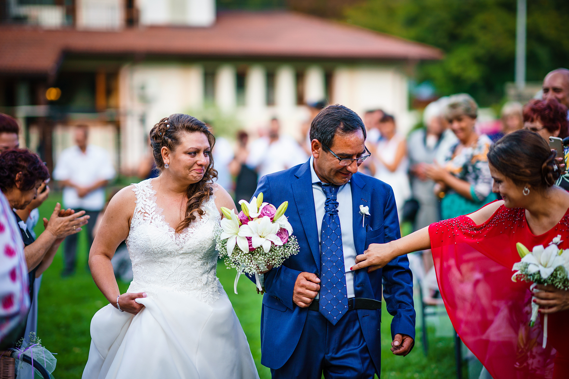 Bulgaria Elopement Photos | The bride, teary-eyed with joy, walks down the aisle with her father