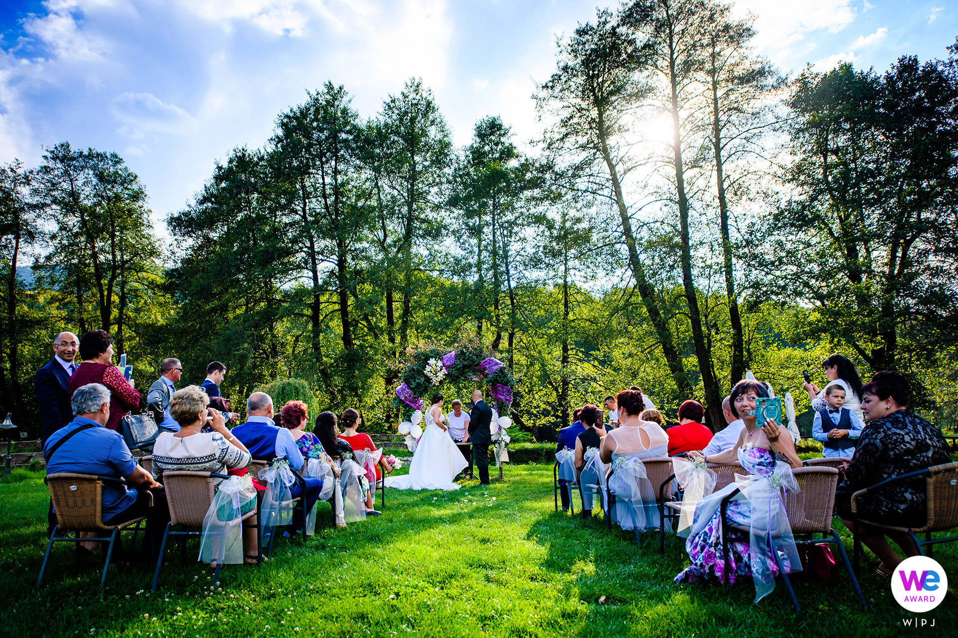 Ribaritsa, Bulgaria Elopement Photographer | the ceremony took place on a green lawn and surrounded by trees