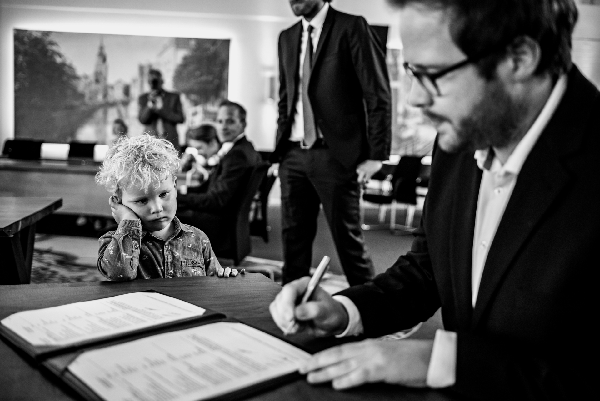 NL Elopement Marriage Images | the groom signs the marriage license