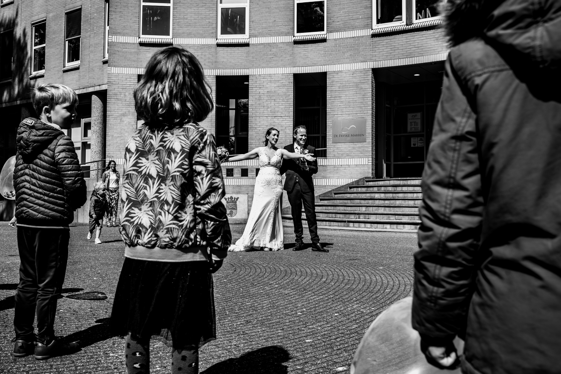 NL Elopement City Hall Photographer | upon leaving the city hall after the ceremony, all of her students were waiting for the newlyweds