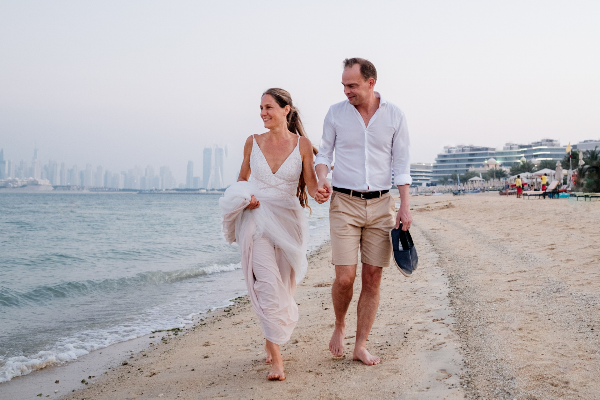 UAE Beach Elopement Couple Image | A sunset walk along the beach