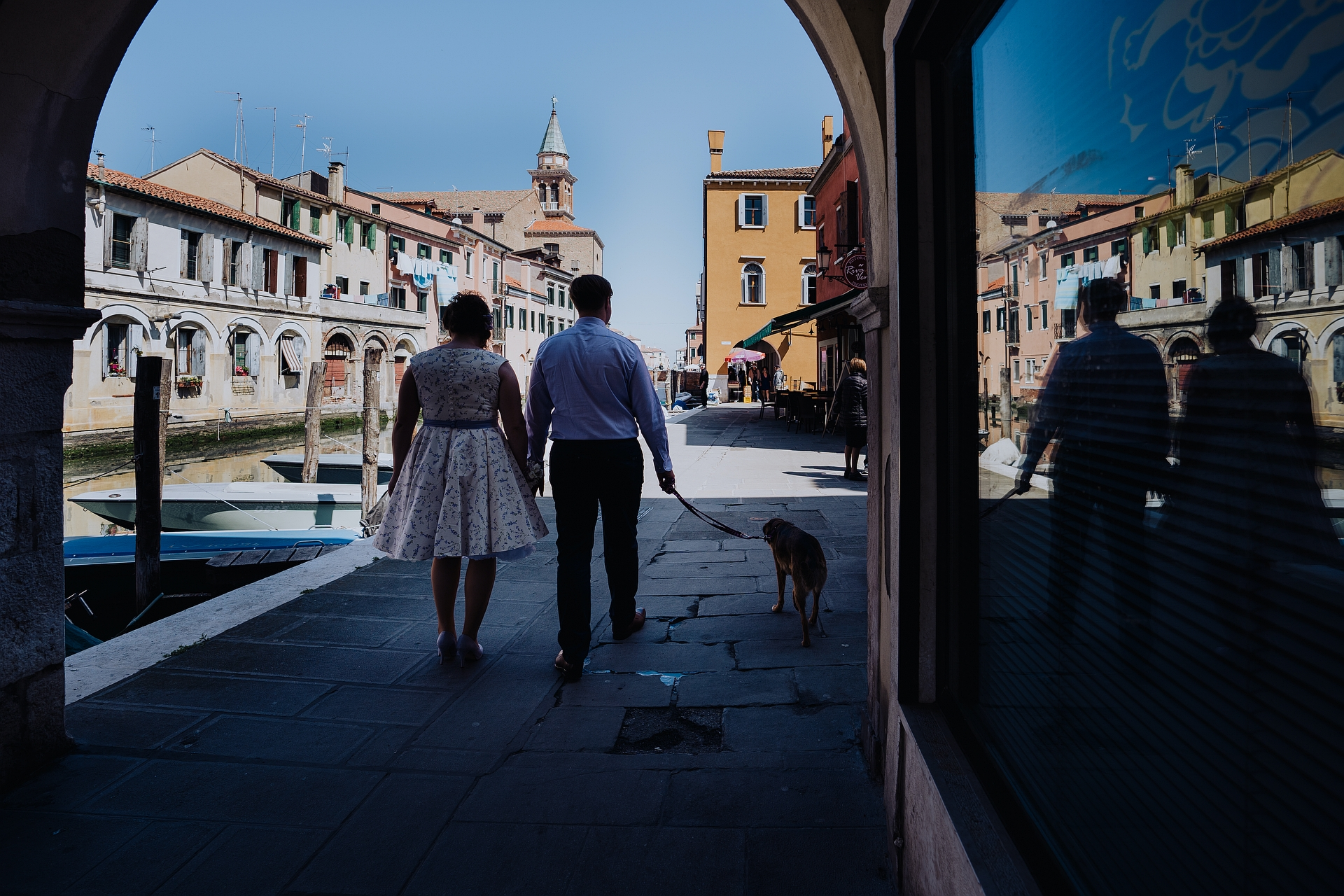 Italy Elopement Photography from Chioggia | The bride and groom take a walk on typical streets