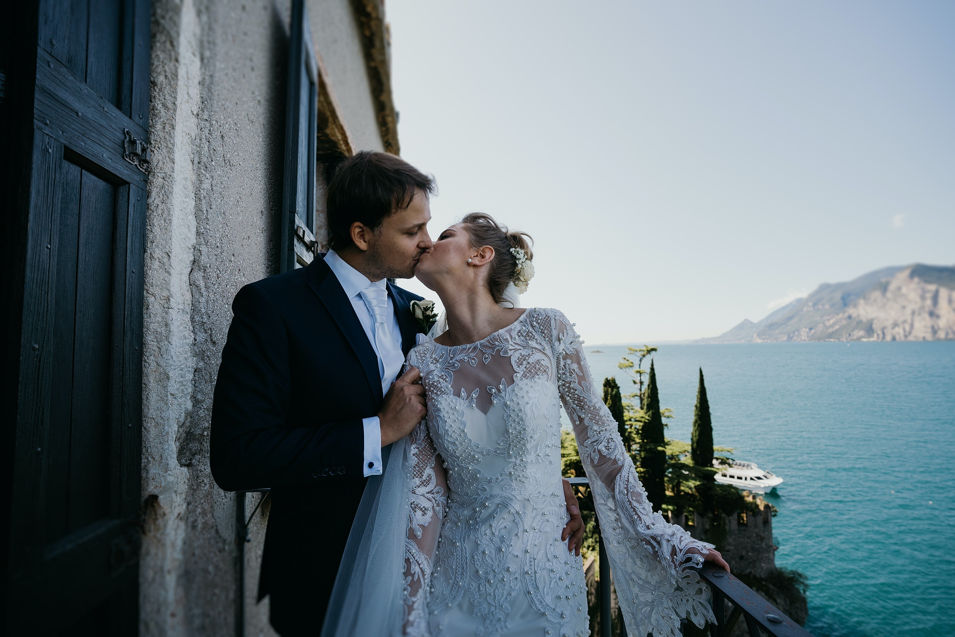 Malcesine Castle IT Elopement Couple Lake Portrait | the wonderful view of the lake behind the bride and groom