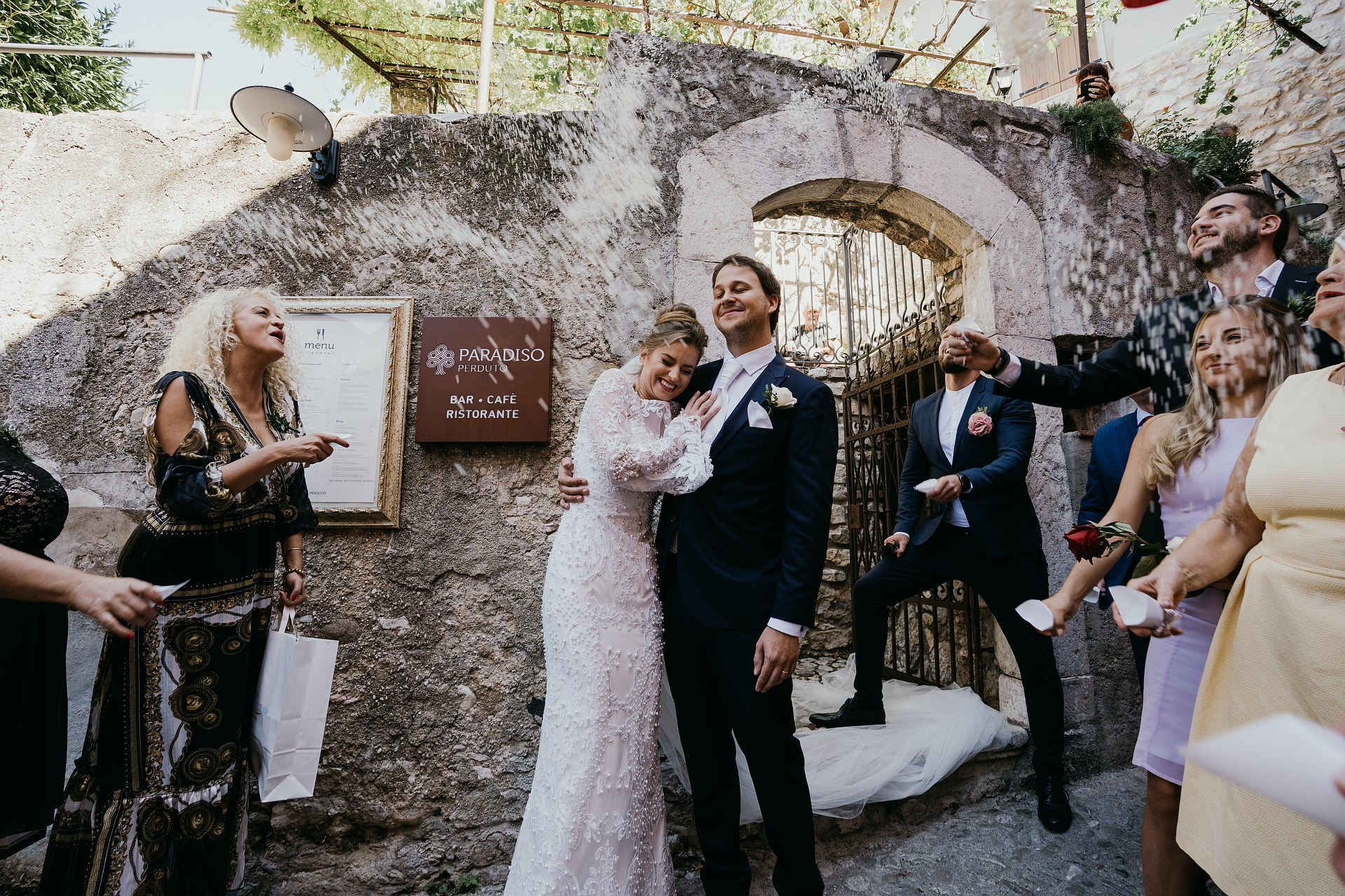 Malcesine - Paradiso Perduto Restaurant Elopement Venue Image | Rice is thrown at the bride and groom