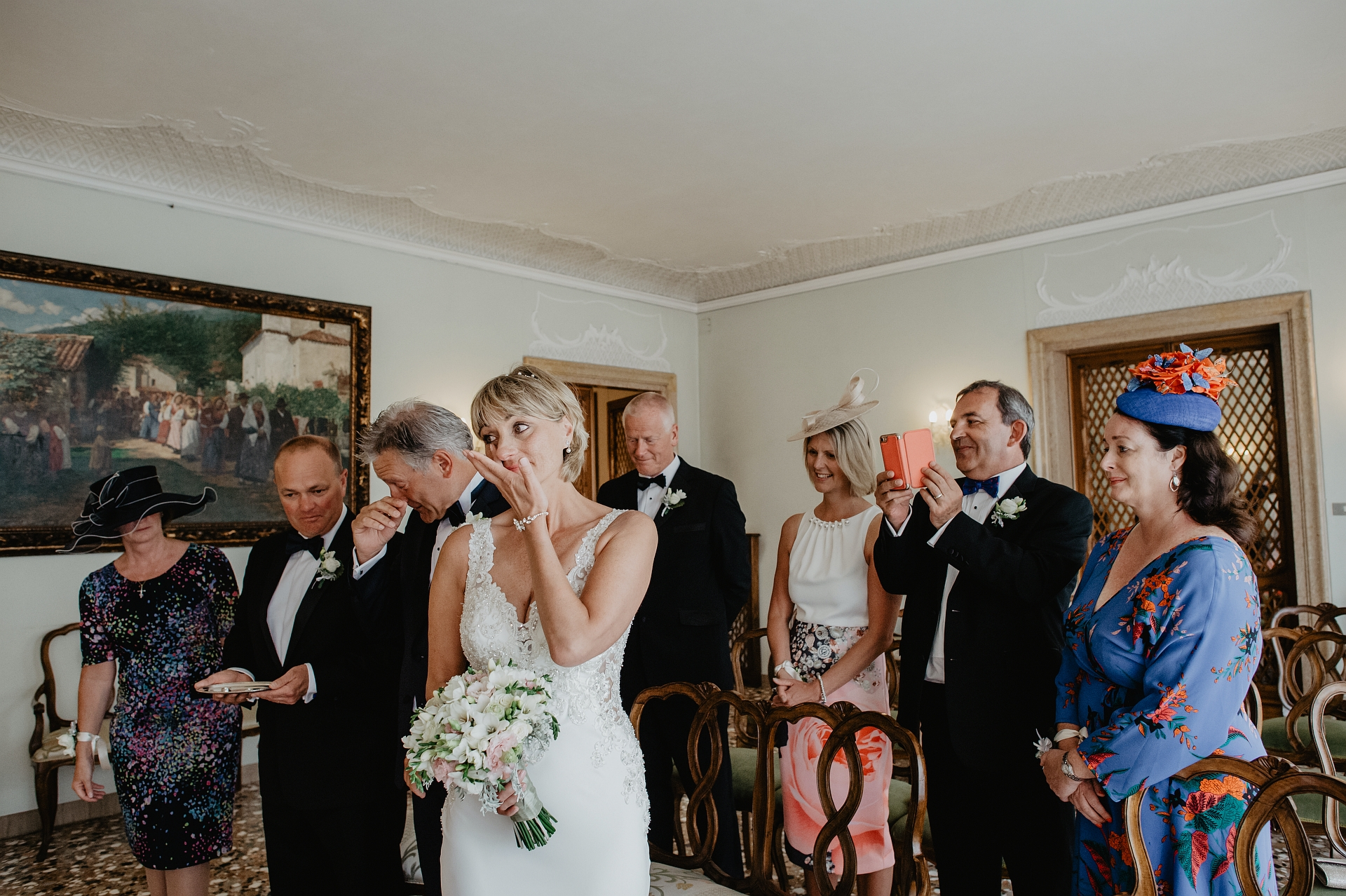 Italy Elopement Ceremony Picture from Venice Town Hall | The bride has entered the room, and the future spouses cannot hold back the very strong emotions