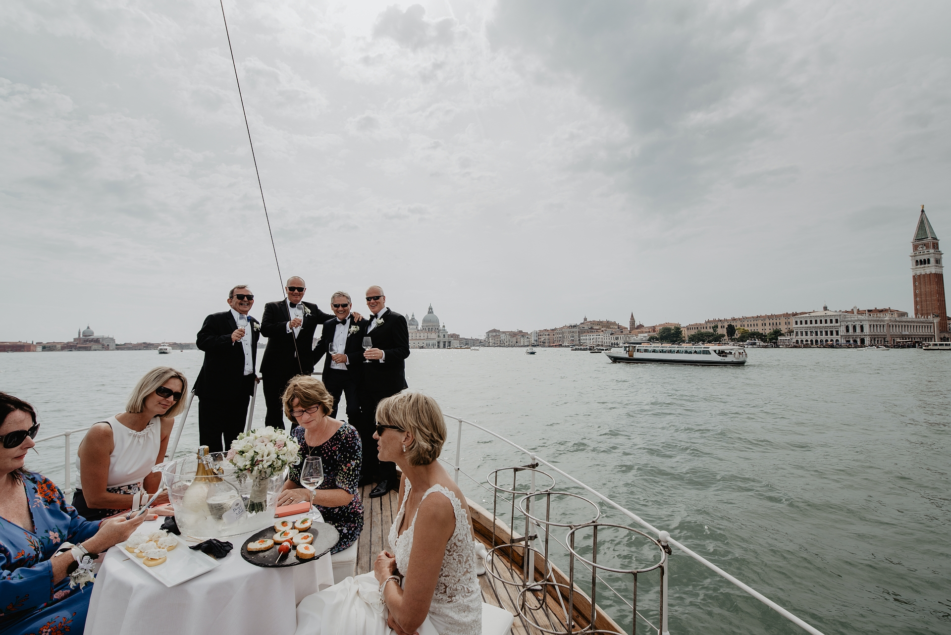 Silver Yacht Private Boat - Venice Lagoon, Italy Elopement Photos | sailing through the magnificent lagoon of Venice, they will celebrate the wedding reception and dinner