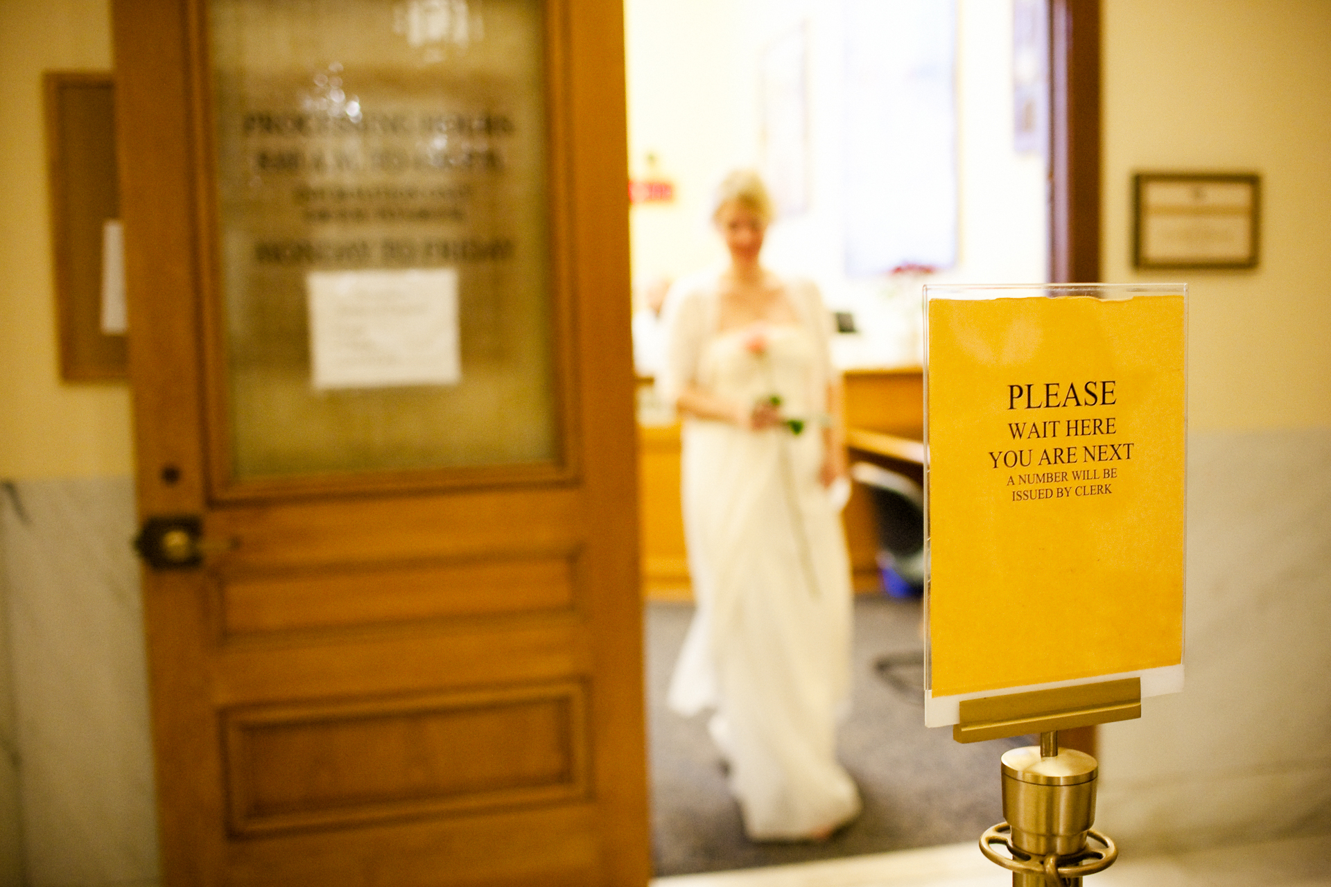 A Civil Elopement Ceremony Image from SF City Hall   Leaving the clerk's office, the bride, carries her single rose