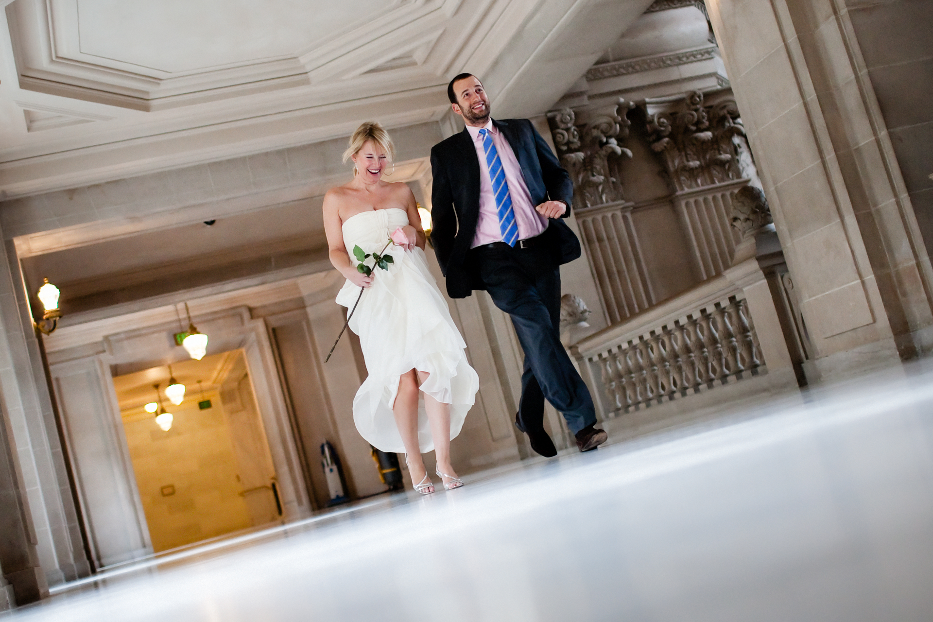 San Francisco, California City Hall Elopement Photographers | Overflowing with joy, the couple can't wait to get out of city hall and start their married life together