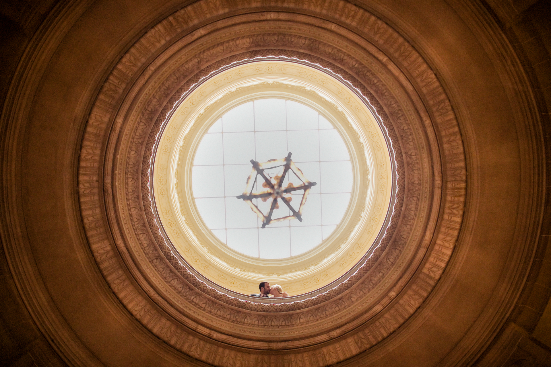 San Francisco City Hall Elopement Images from California   Looking up at the large rotunda of City Hall, the couple stands near the top