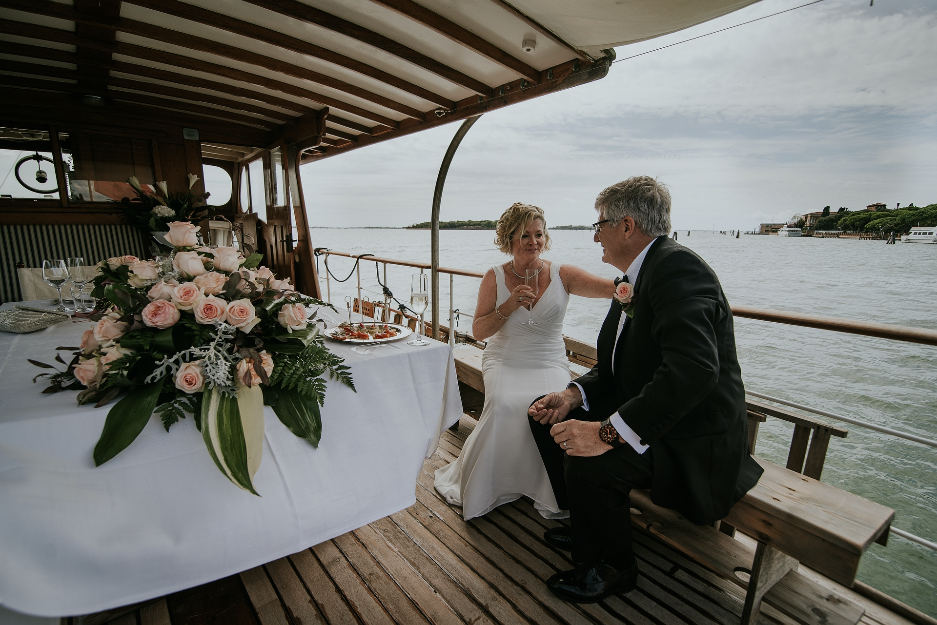 Silver Yacht - Venice Lagoon, Italy Elopement Reception Image | the couple reached the Silver Yacht by taxi and were welcomed on board