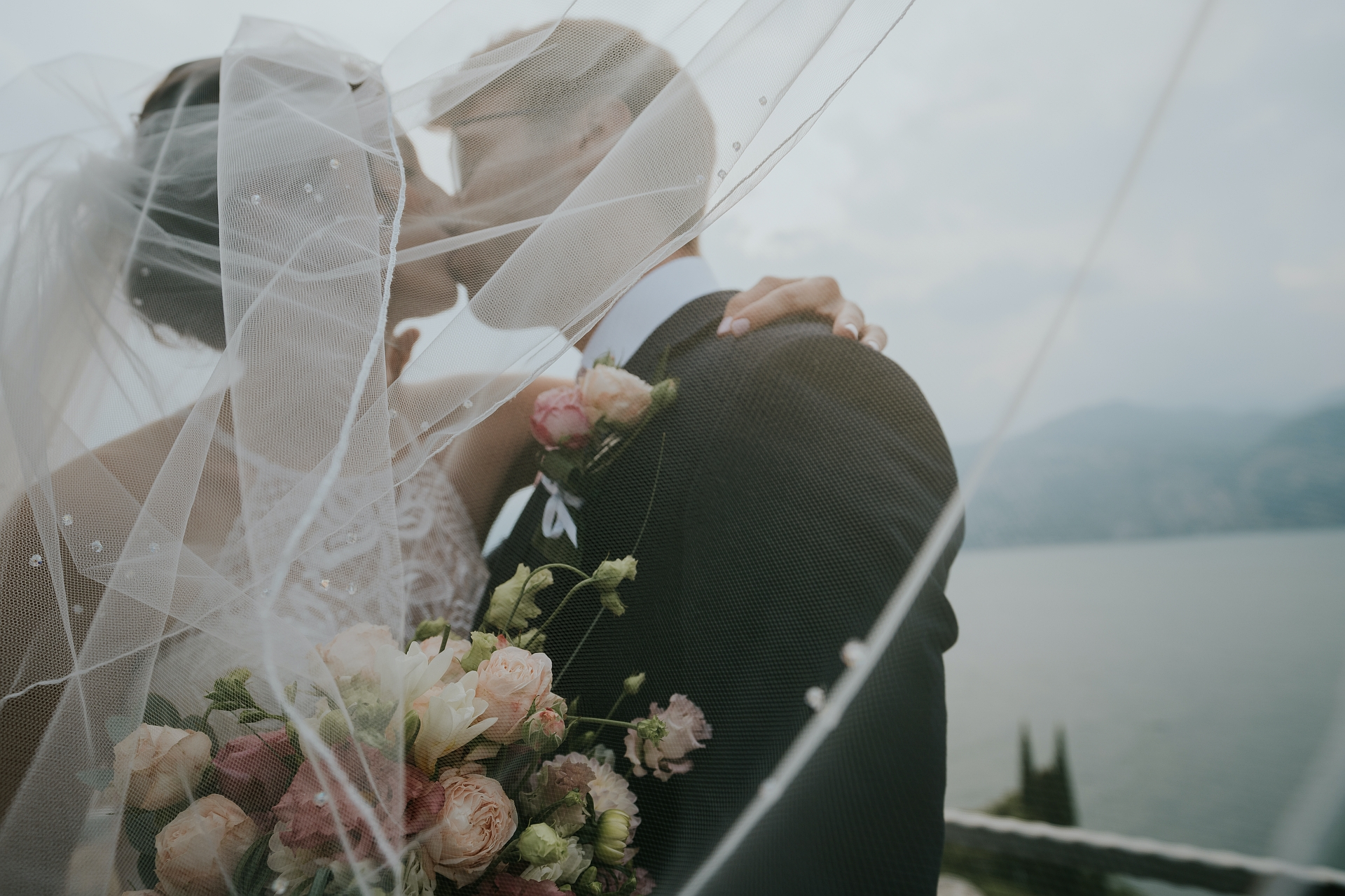 Italy Castle Elopement Ceremony Kissing Couple Photo | A portrait of the bride and groom