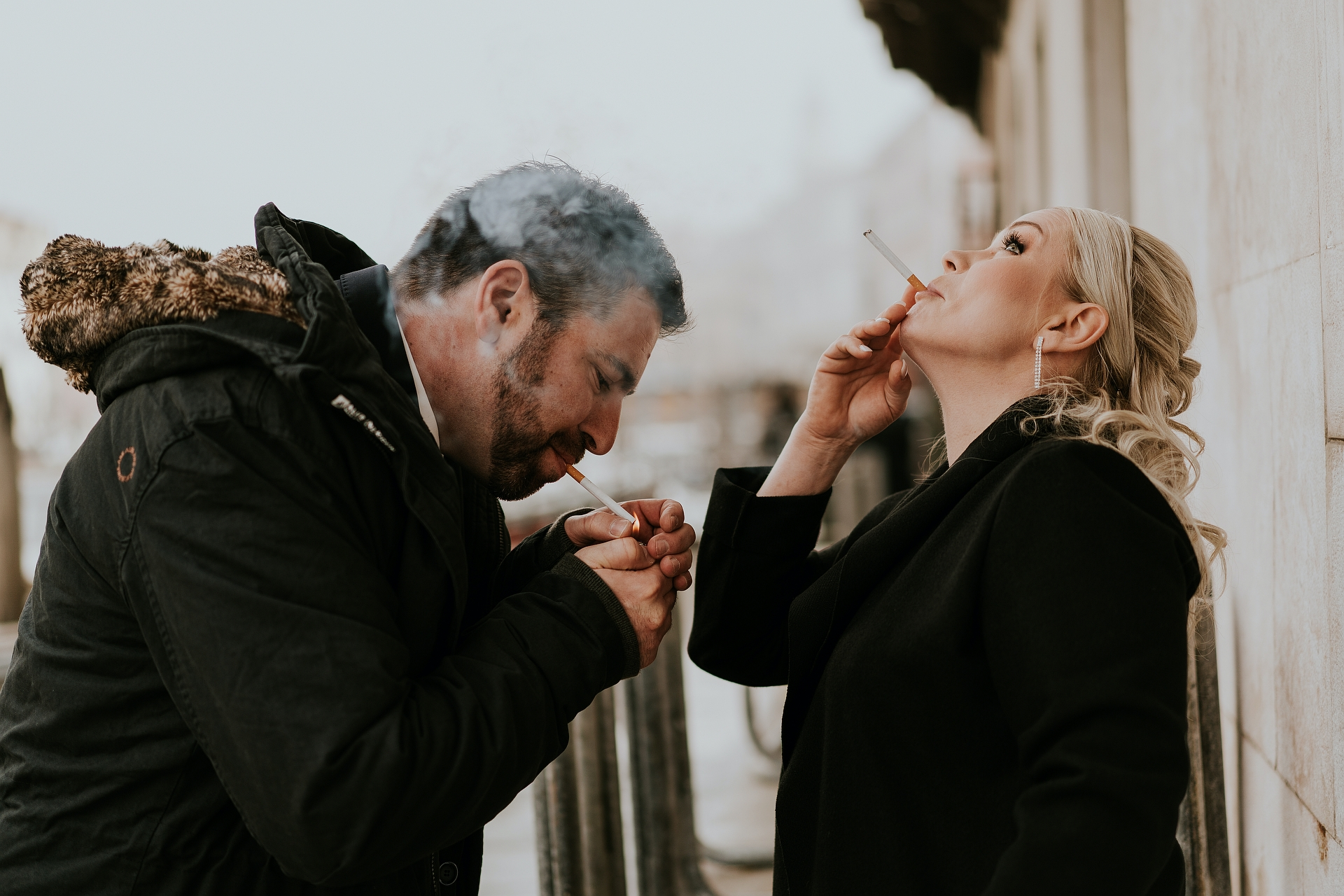 Venice Wedding Photographer for Elopements | The bride and groom wear coats to shelter from the cold
