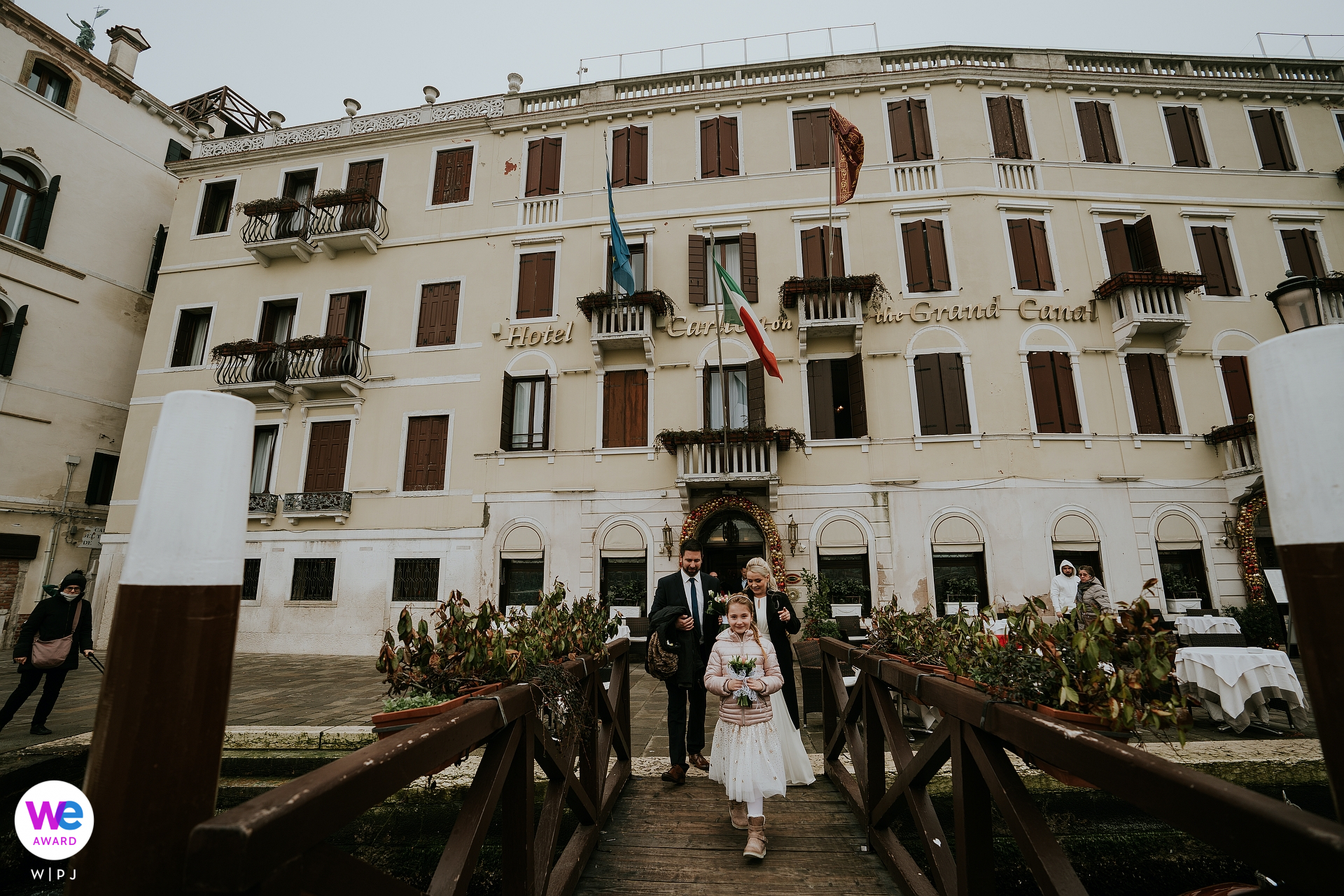 Hotel Carlton On The Grand Canal, Venezia, Veneto, Italy Elopement Photographer | The bride and groom cross the pier to reach the taxi waiting for them