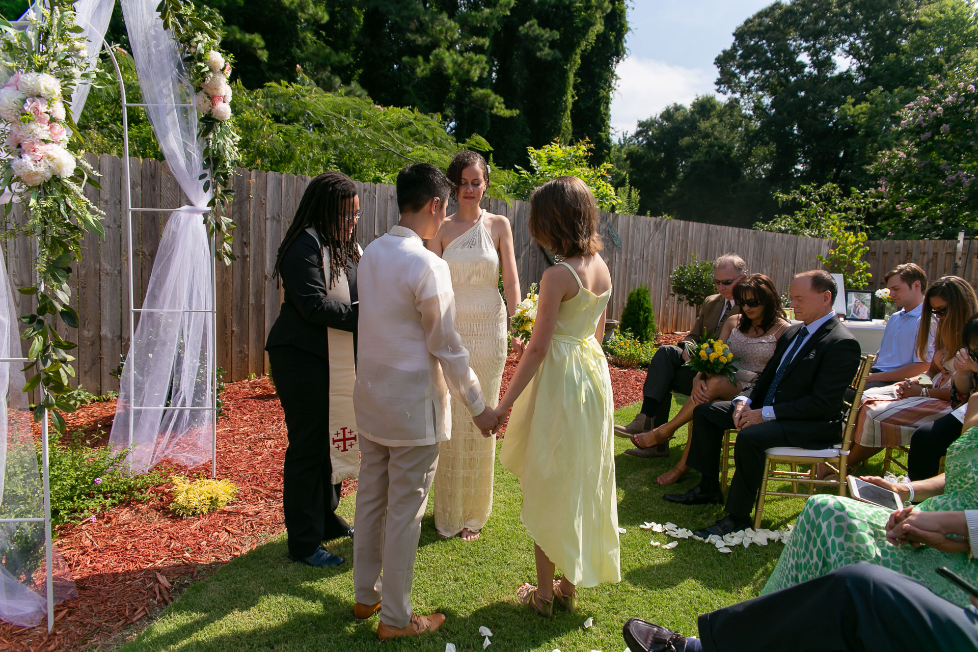 Backyard At-Home Elopement Ceremony Photo | The couple pray during the ceremony