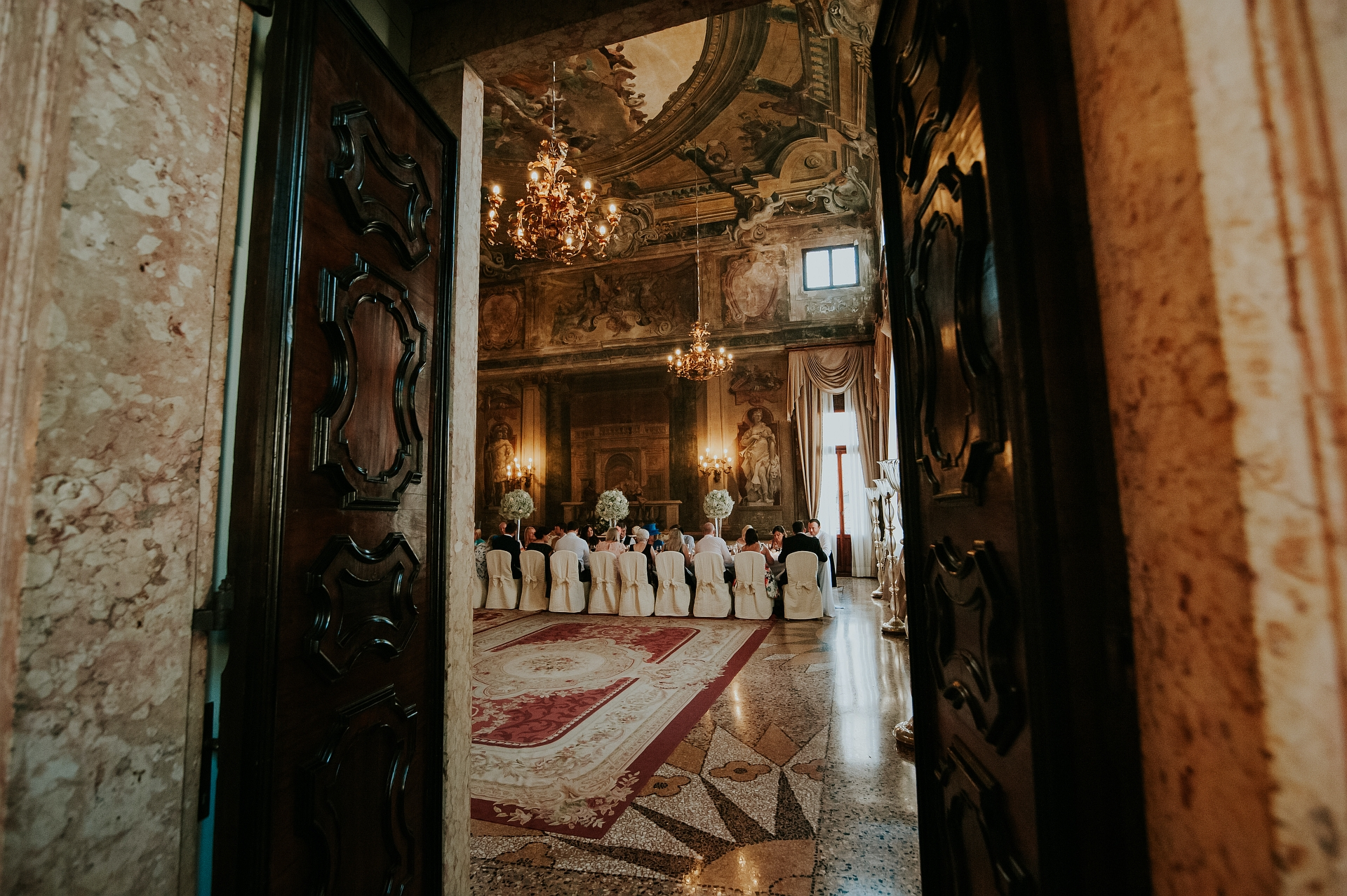 Venice Italy Elopement Image - CA' Sagredo | A view of the wedding lunch and the spectacular Sala Della Musica