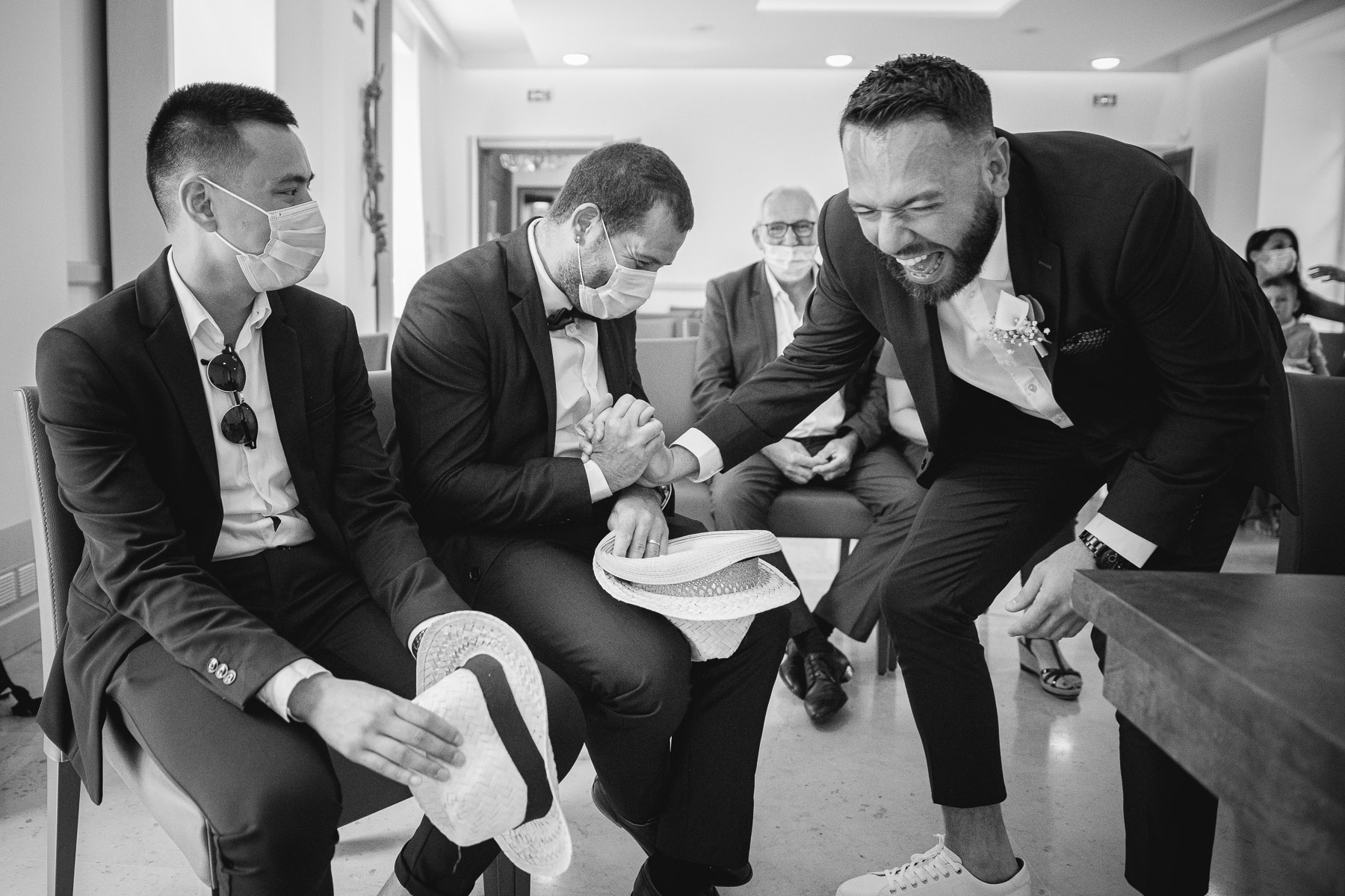Pontault Combault City Hall Elopement Ceremony Image | The groom has a hearty laugh with some of the guests