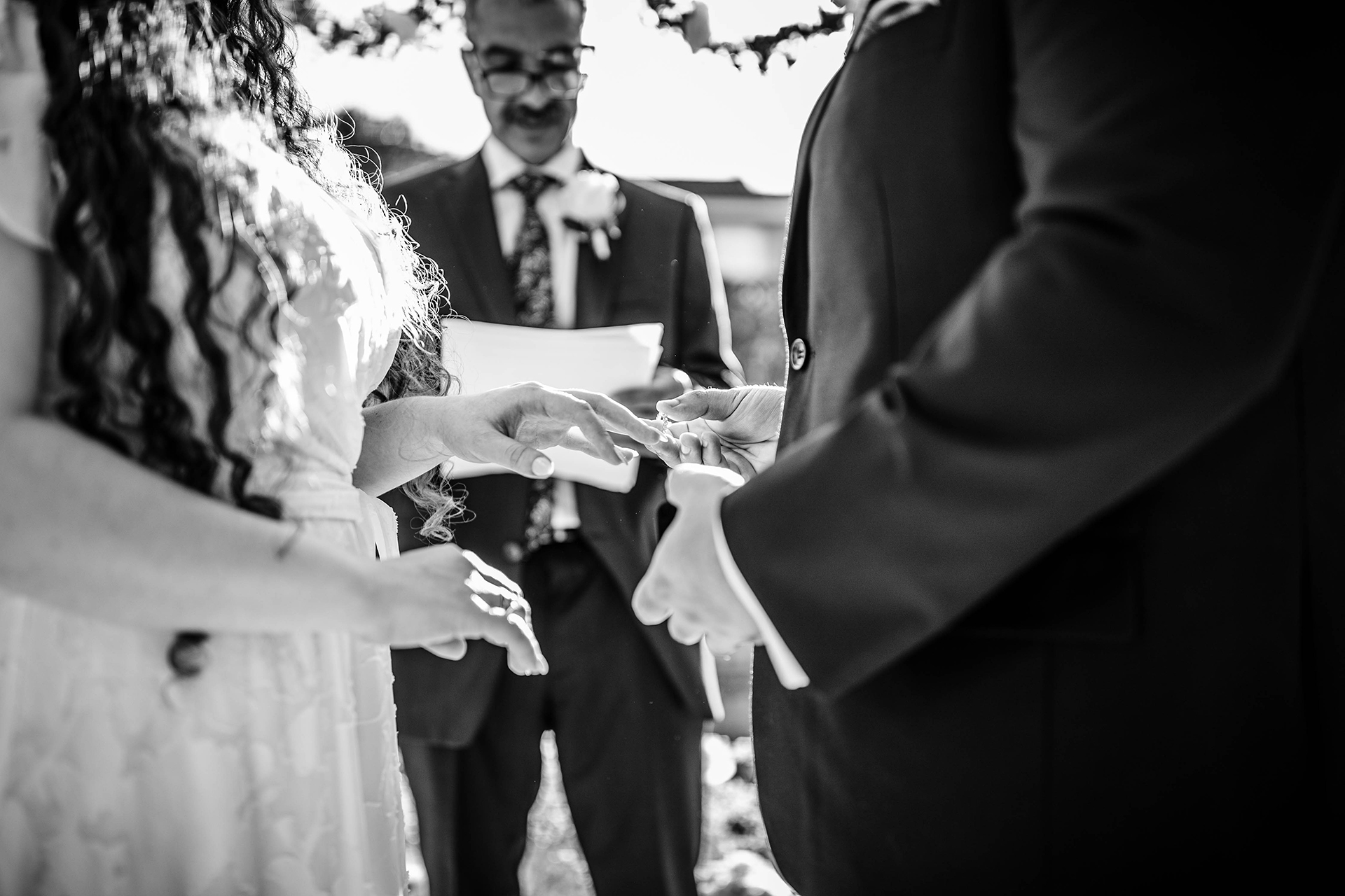 Northern California Elopement Ceremony Photo | The groom's father, serving as officiant, directs the couple to exchange rings
